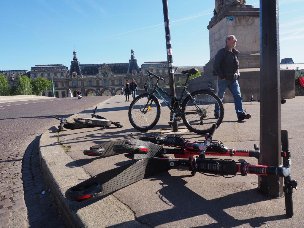 Electric scooters lie on the Pont du Carrousel bridge in Paris, France. Christian Böhmer—picture alliance via Getty Images