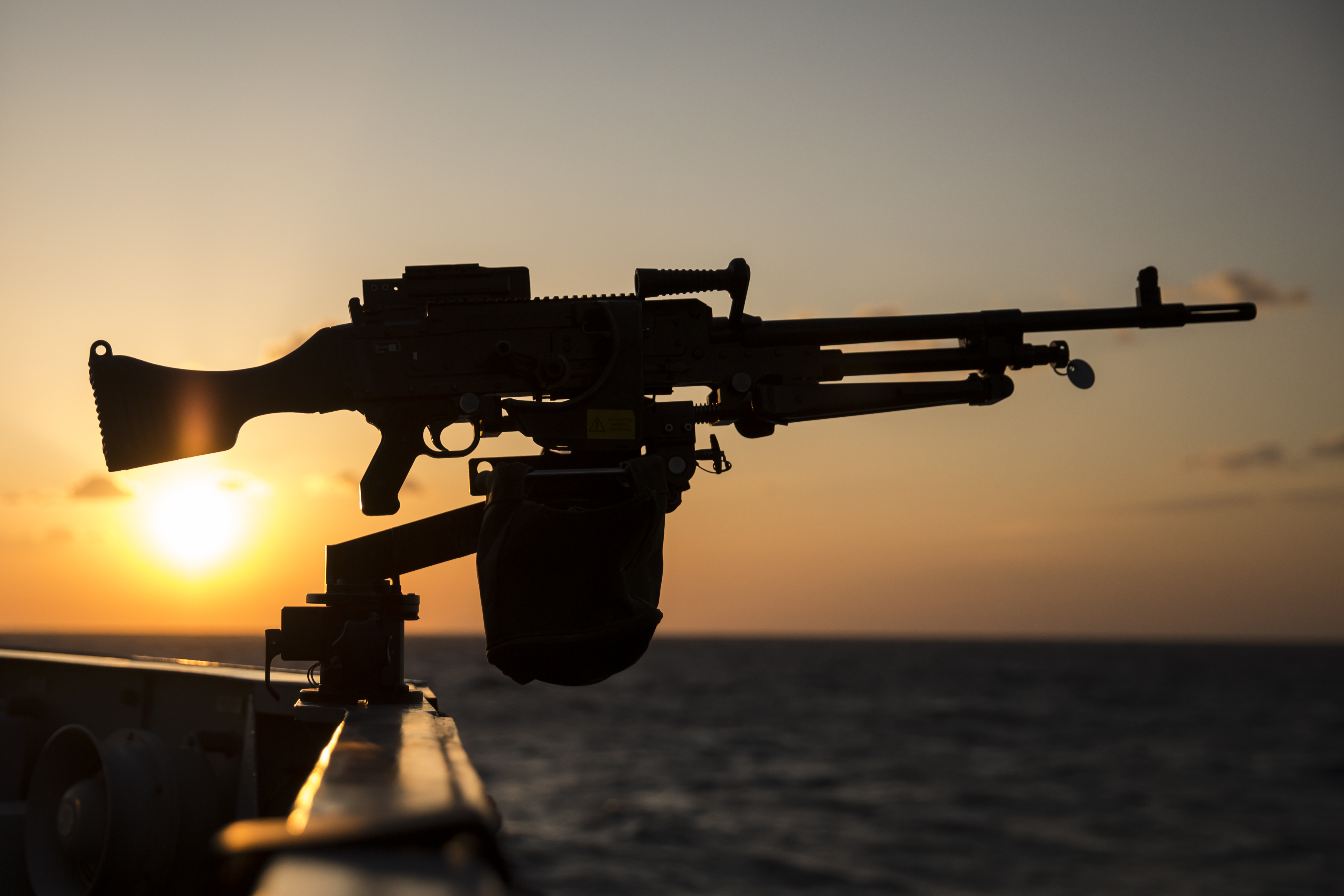 he sun sets seen from the deck of British Royal Navy's HMS Montrose frigate