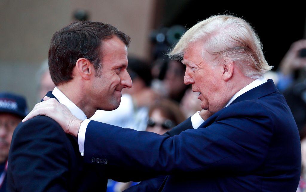 Emmanuel Macron greets Donald Trump