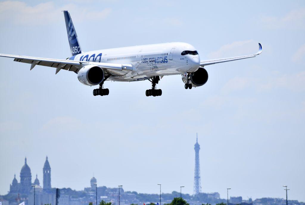An Airbus A350 XWB is seen above the Paris skyline at the Paris Air Show.