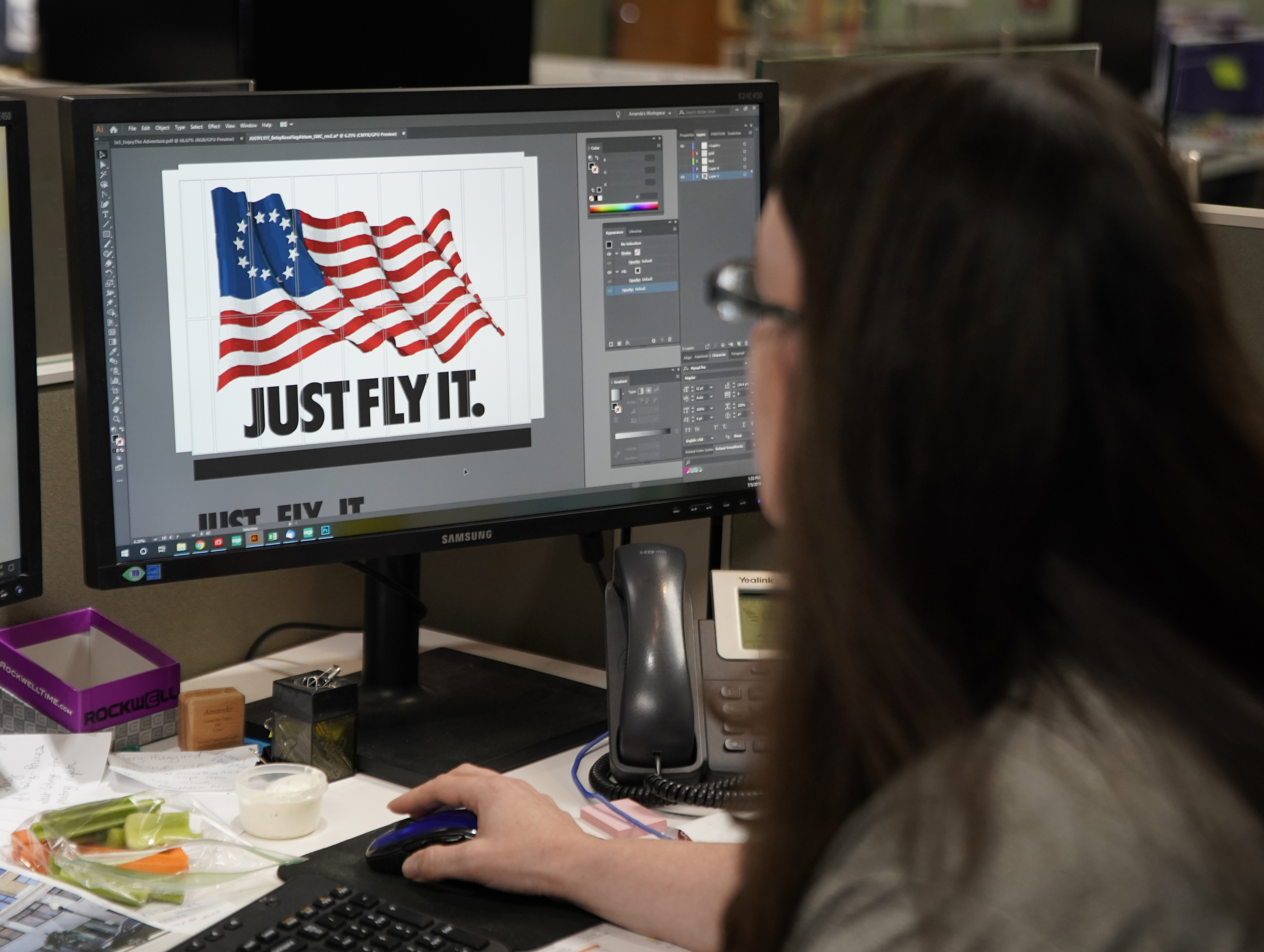 A worker designs a Just Fly It t-shirt with the Betsy Ross flag at Colonial Flag on July 5, 2019 in Salt Lake City, Utah.