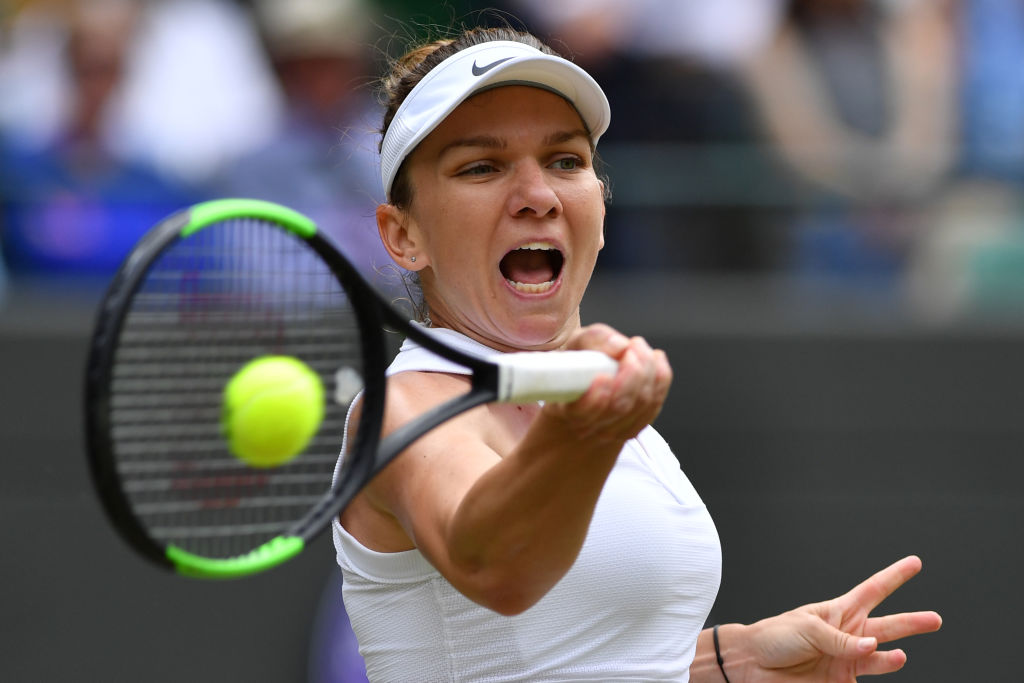 Simona Halep returns a shot in her quarter-final match against Shuai Zhang