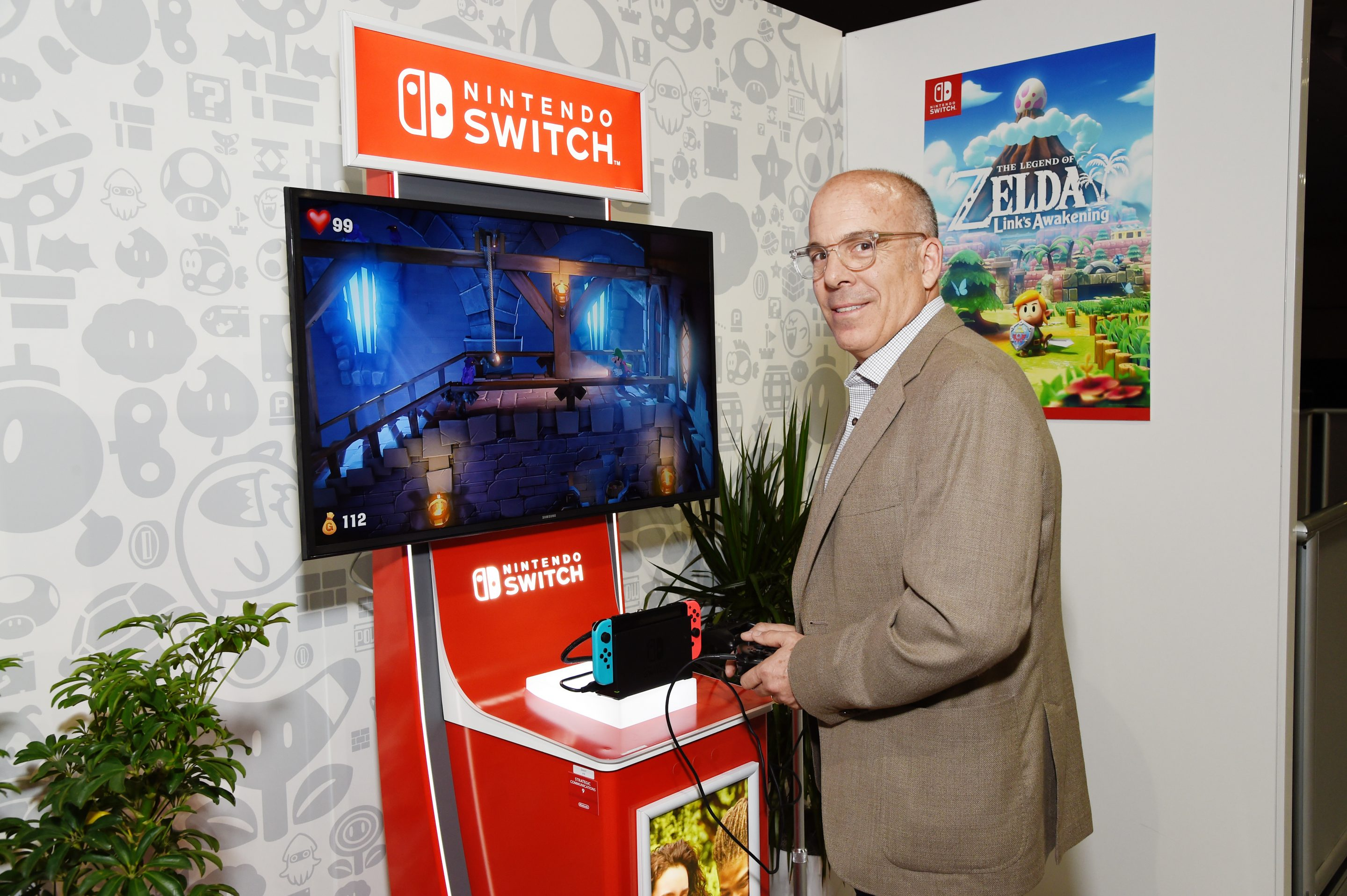LOS ANGELES, CALIFORNIA - JUNE 13: Nintendo of America President and COO Doug Bowser checks out 'Luigi's Mansion 3' for the Nintendo Switch system during the 2019 E3 Gaming Convention at the Los Angeles Convention Center on June 13, 2019 in Los Angeles, California. While its competitors look to mainstream streaming games, Nintendo continues to perfect the portable video game console. (Photo by Michael Kovac/Getty Images for Nintendo)