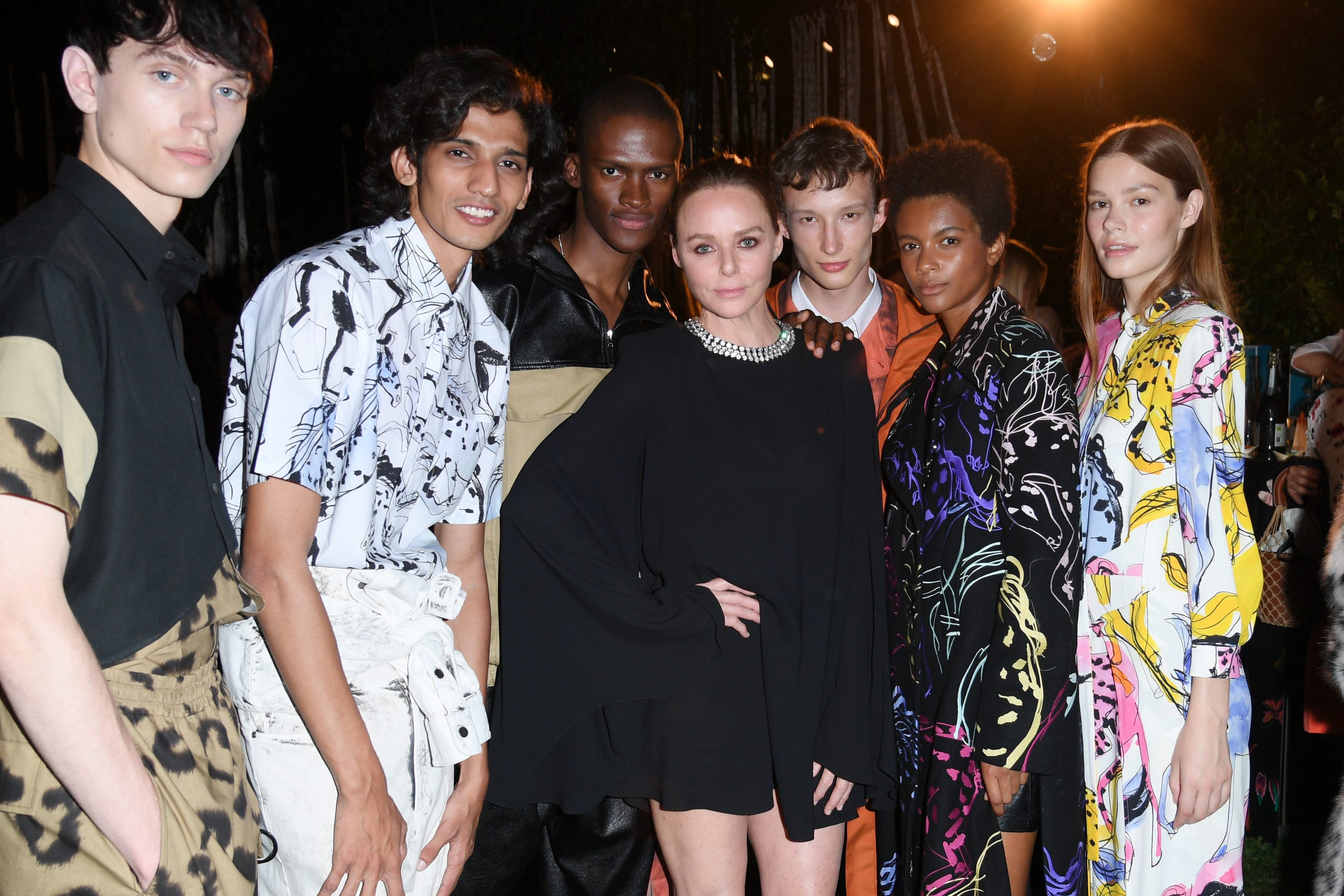 Stella McCartney with models at her June 14 fashion show during Milan Men's Fashion Week Spring/Summer 2020.