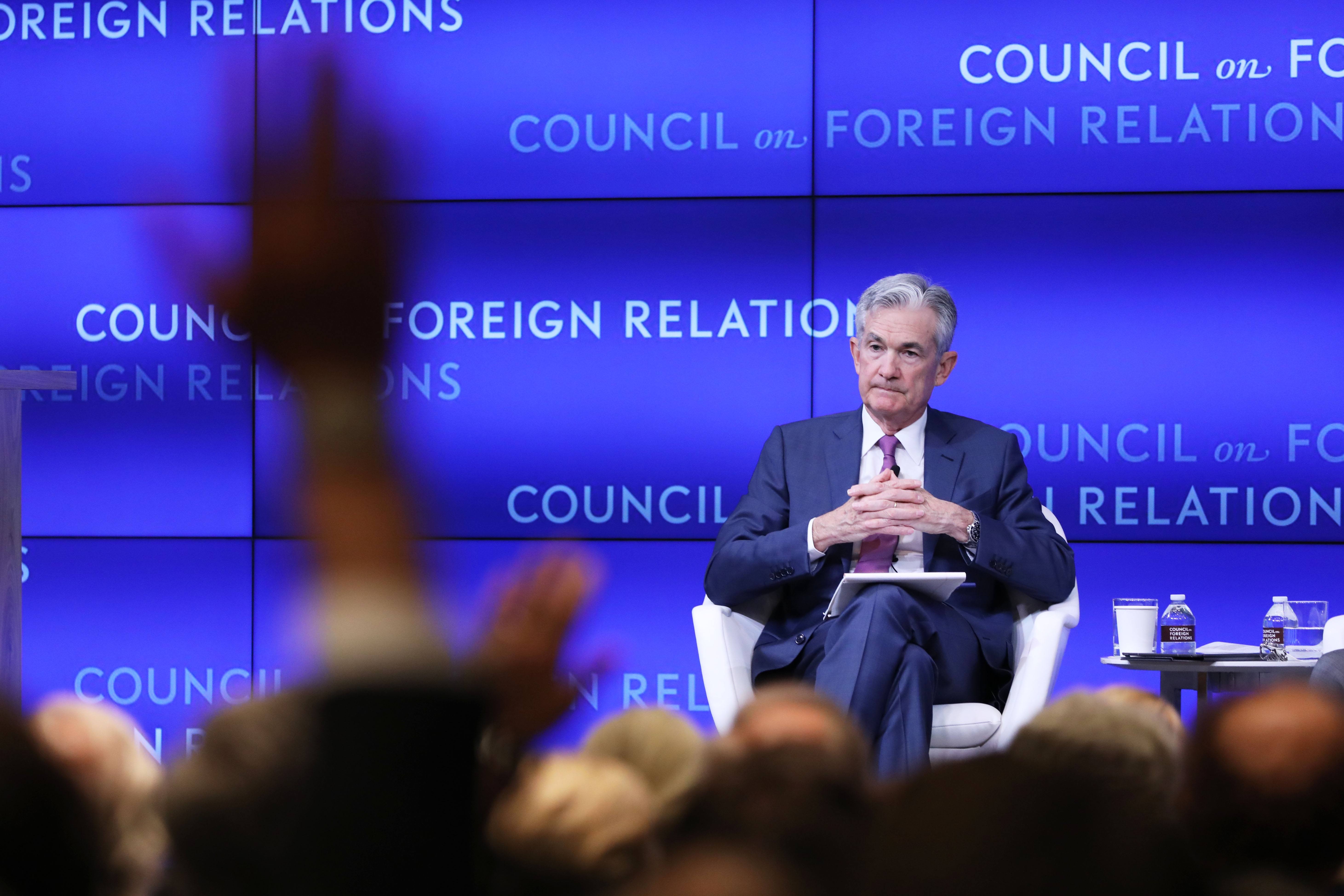 Jerome Powell (left), chairman of the Board of Governors of the Federal Reserve, takes questions while speaking in conversation with Neil Irwin of the New York Times at the Council on Foreign Relations on June 25, 2019 in New York City. Powell discussed the challenges facing the U.S. economy and the policies of the U.S. Federal Reserve.   (Photo by Spencer Platt/Getty Images)