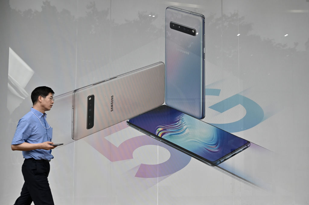 A man walks past an advertisement for the Samsung Galaxy S10 5G smartphone in Seoul on July 31, 2019