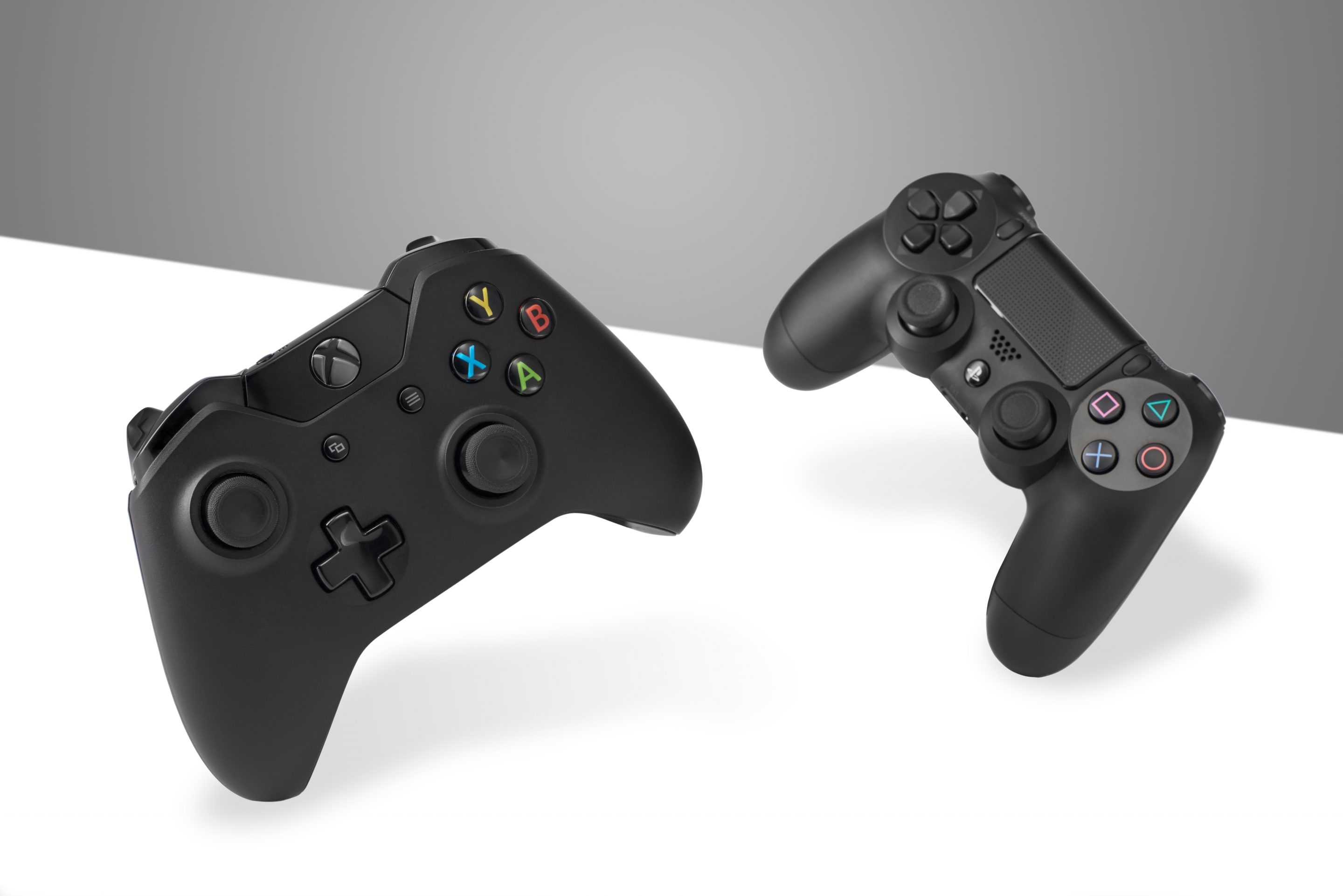 A Sony DualShock 4 wireless controller (R) and Microsoft Xbox One wireless controller, taken on January 22, 2016. (Photo by Olly Curtis/Future Publishing via Getty Images)