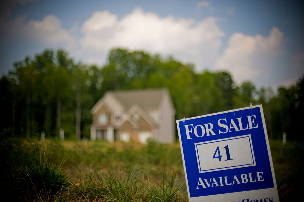 A for sale sign is posted in front of a home in Forsyth County north of Atlanta, Georgia. (Photo by Chris Rank/Corbis via Getty Images)