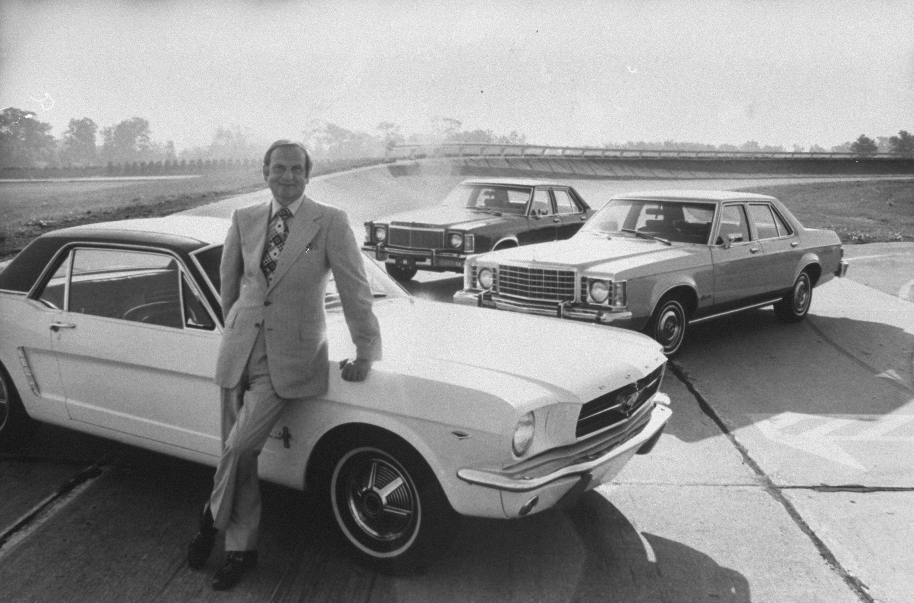 Ford Motor Co. president Lee A. Iacocca, leaning against a Ford Mustang in January 1974.