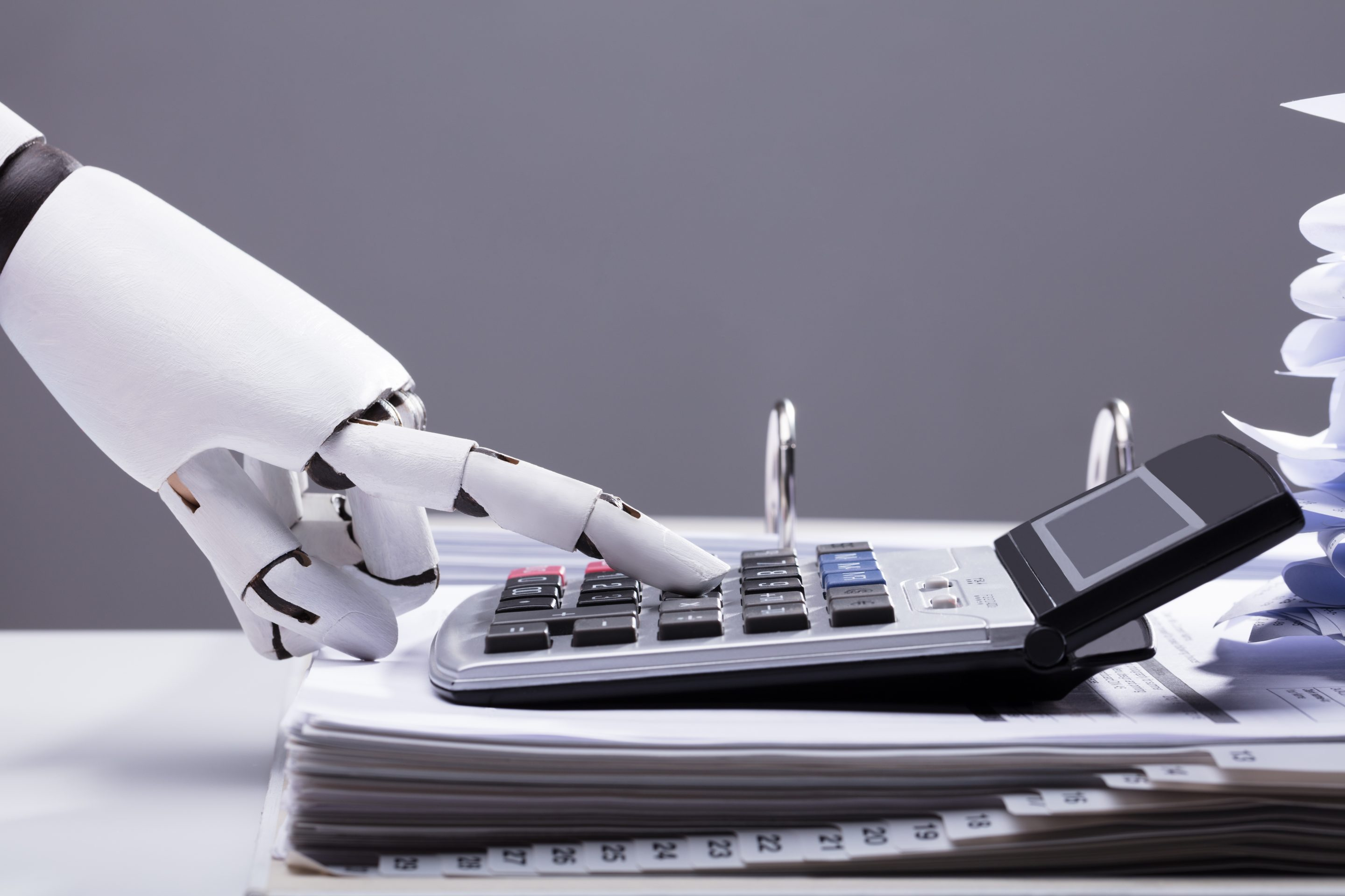 Robotic Hand Using Calculator In Office