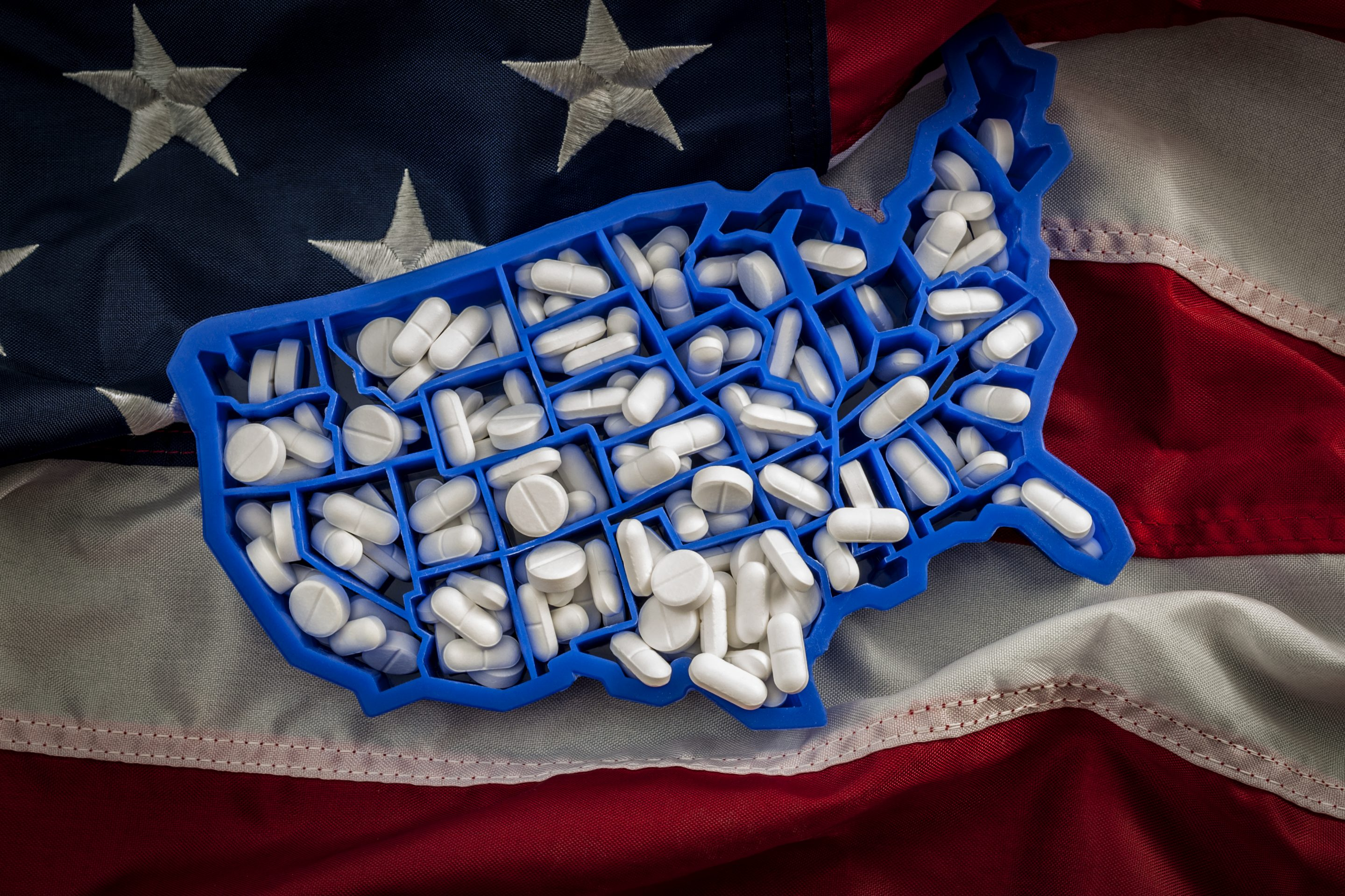 American map covered with opioid painkillers like oxycodone and hydrocodone