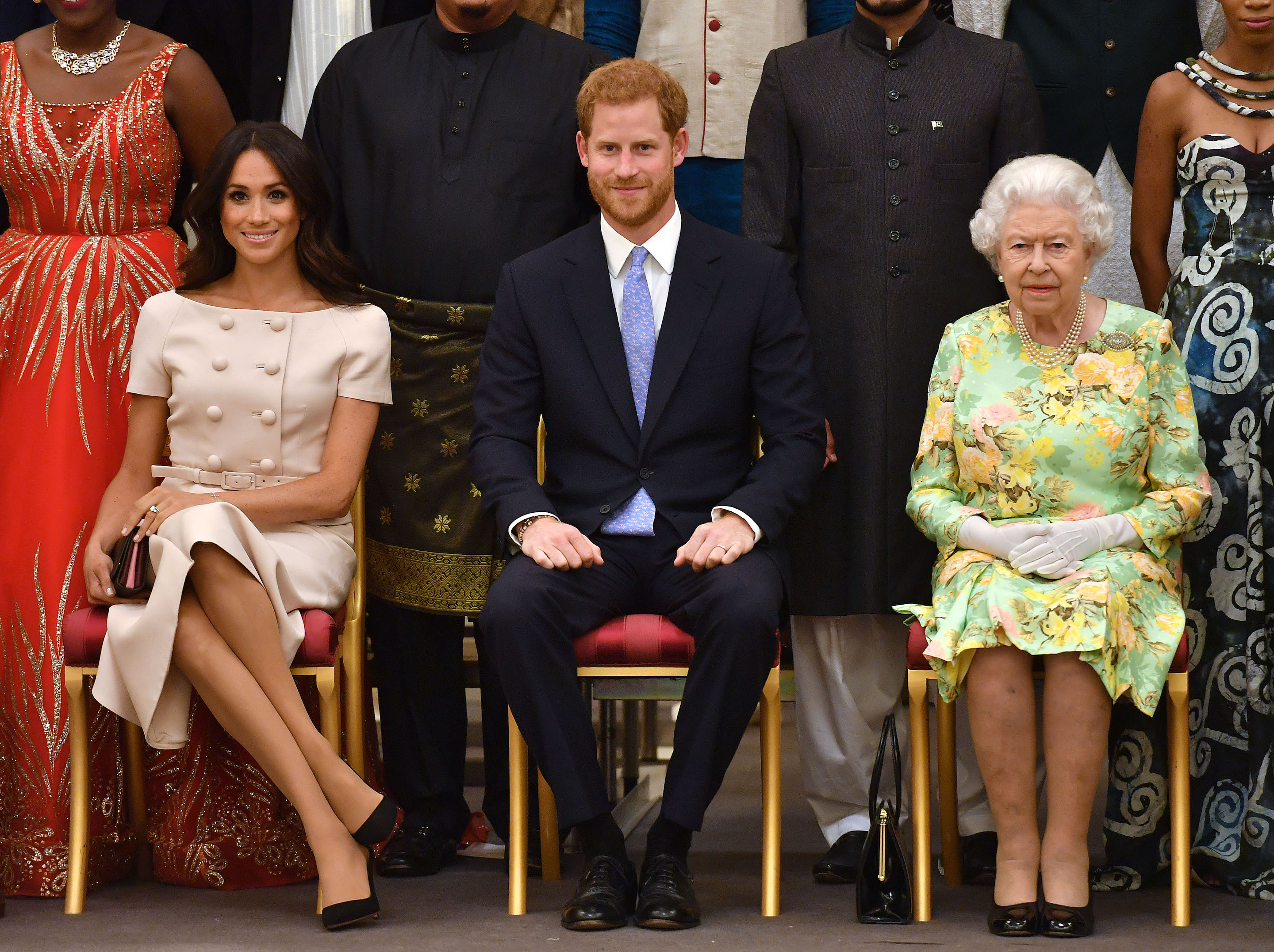 Britain's Duchess of Sussex Megan Markle, Prince Harry, Duke of Sussex, and Queen Elizabeth II during the Queen's Young Leaders Awards Ceremony on June 26, 2018, at Buckingham Palace.