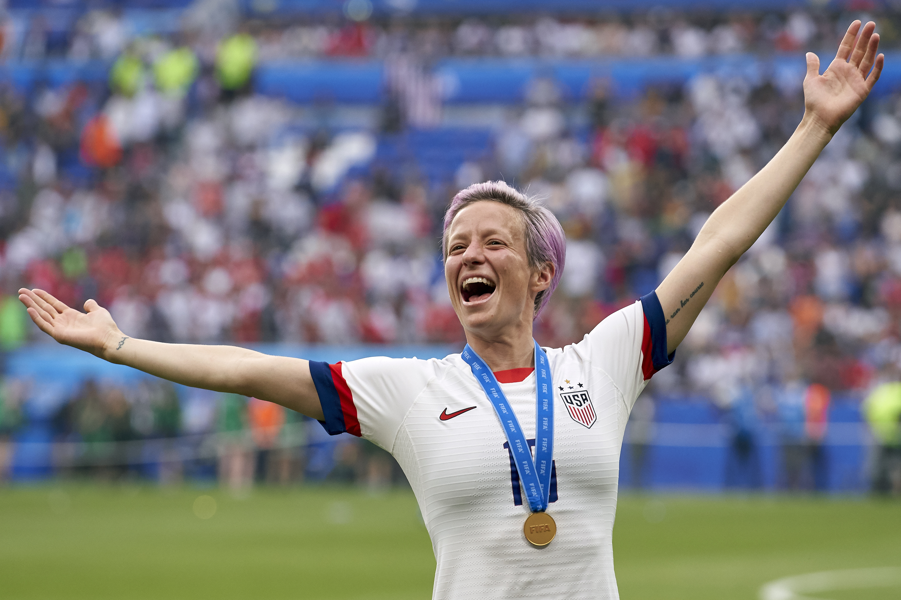 Megan Rapinoe Victory Pose-FIFA Women's World Cup Champs