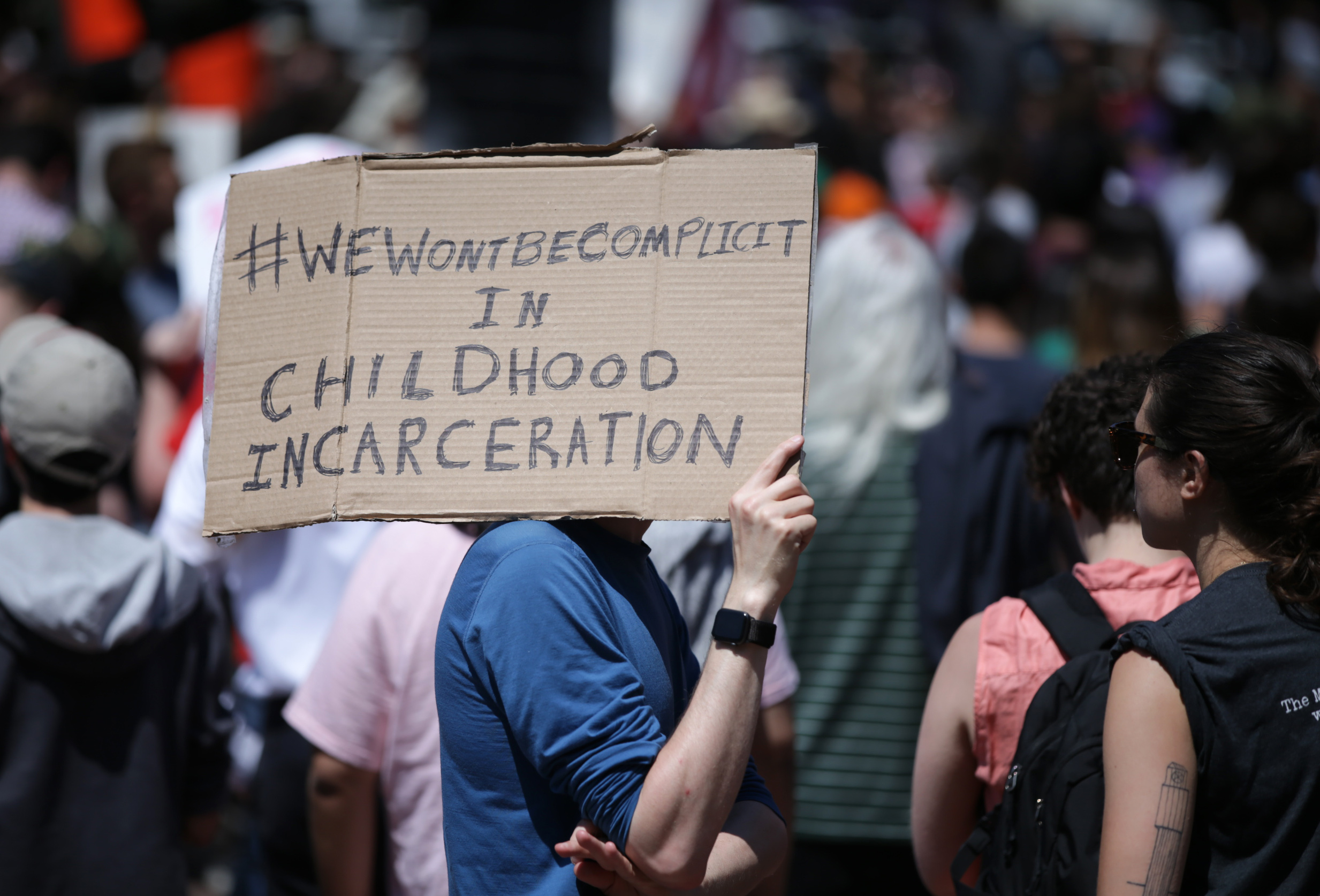 A participant carries a sign as Wayfair employees and others stage at a rally at Copley Square in Boston on June 26, 2019. On June 19, employees at Wayfair learned BCFS - a government contractor that has been managing facilities for migrant children detained at the southern US border - ordered $200,000 worth of bedroom furniture to be shipped to the site of a future 1,600-bed shelter in Carrizo Springs, Texas.