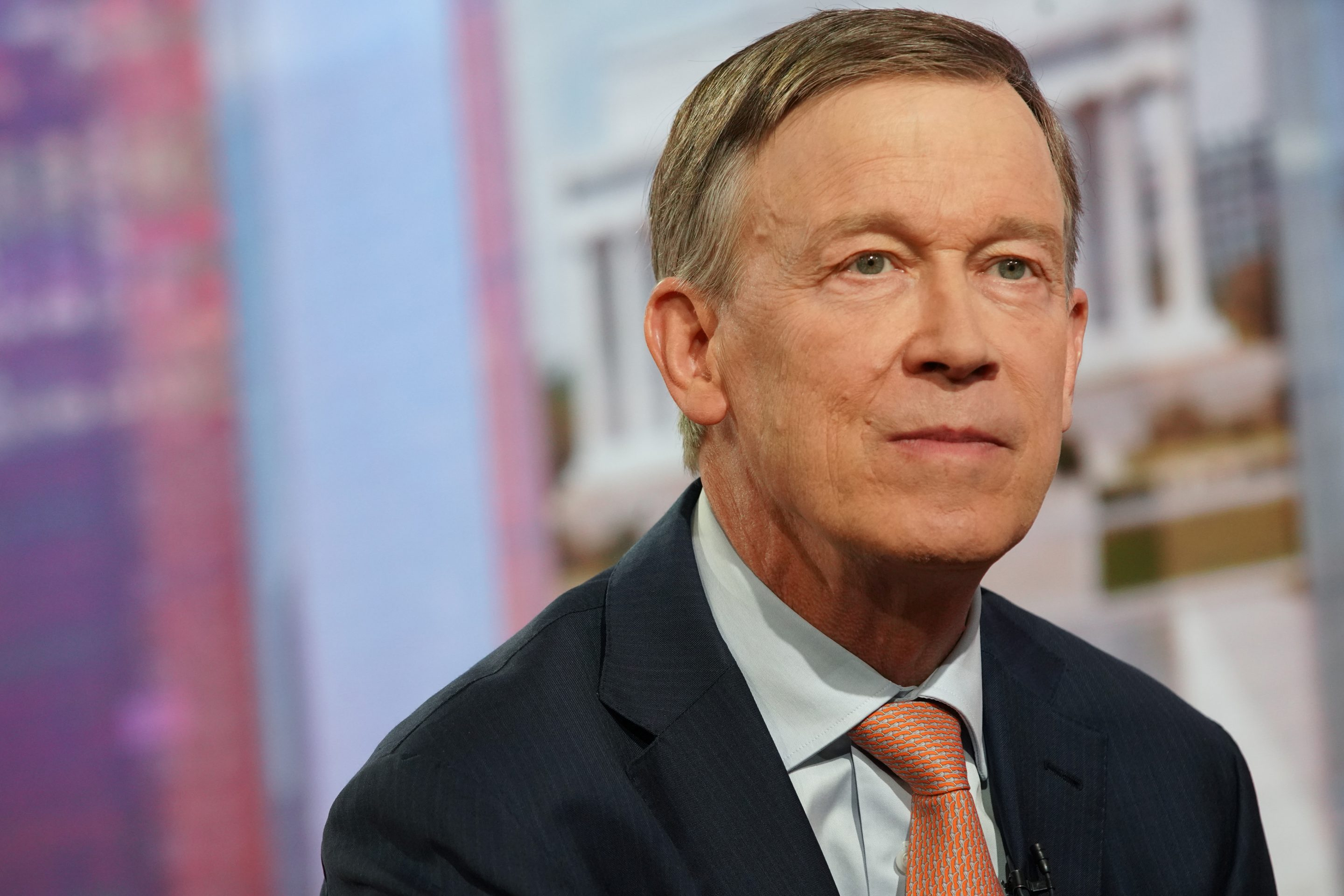 John Hickenlooper, former governor of Colorado and 2020 presidential candidate, listens during a Bloomberg Television interview in New York, U.S., on Friday, July 19, 2019.