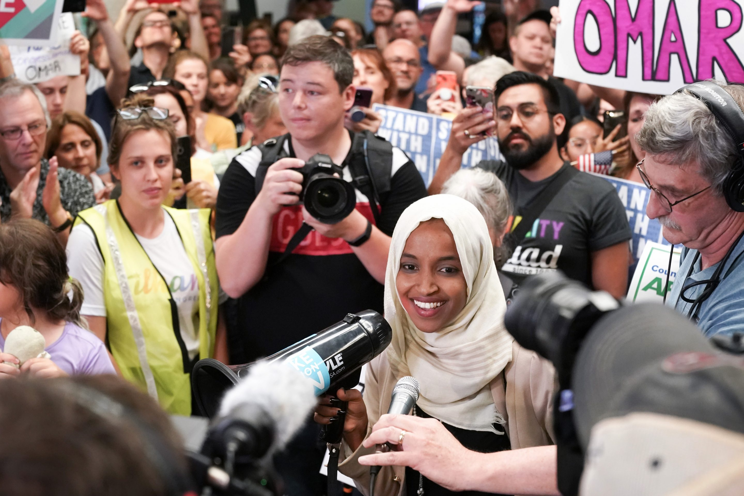 "Rep. Ilhan Omar was greeted by more than a hundred supporters cheering ""Welcome Home Ilhan"" upon arrival to her home state."