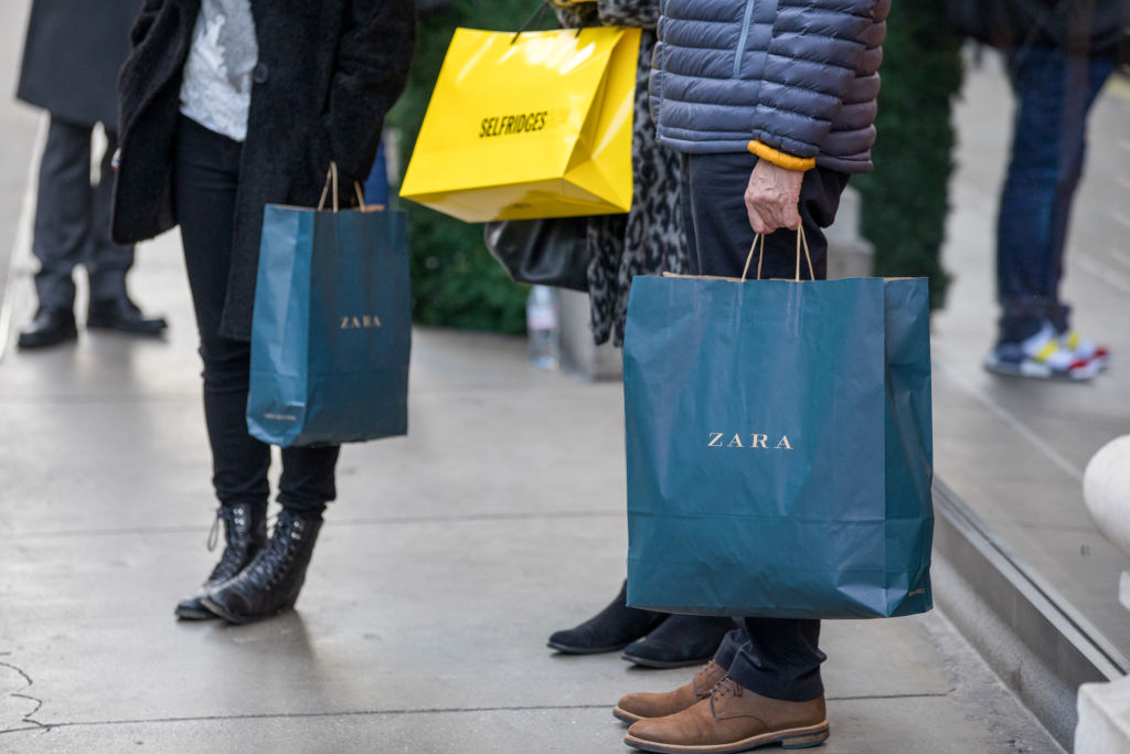 Shoppers carry Zara bags in the U.K.