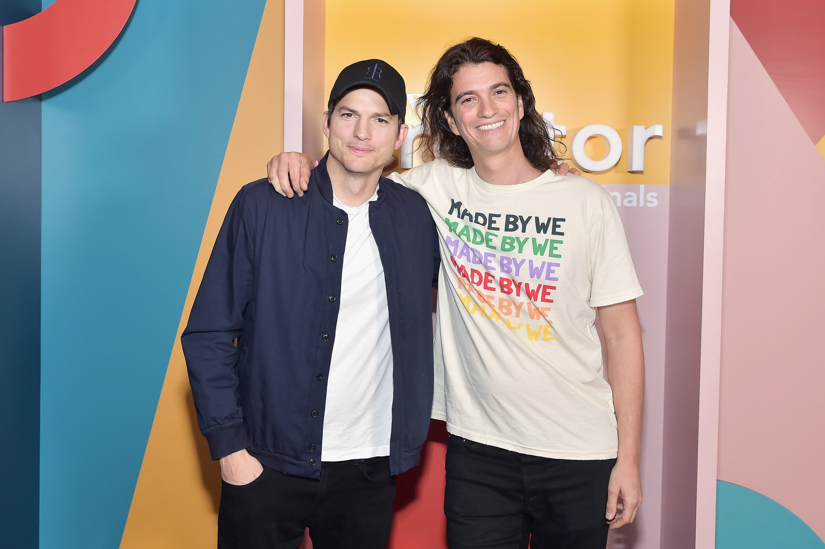 Ashton Kutcher (left) and Adam Neumann attend a WeWork-sponsored event in Los Angeles in January 2019.