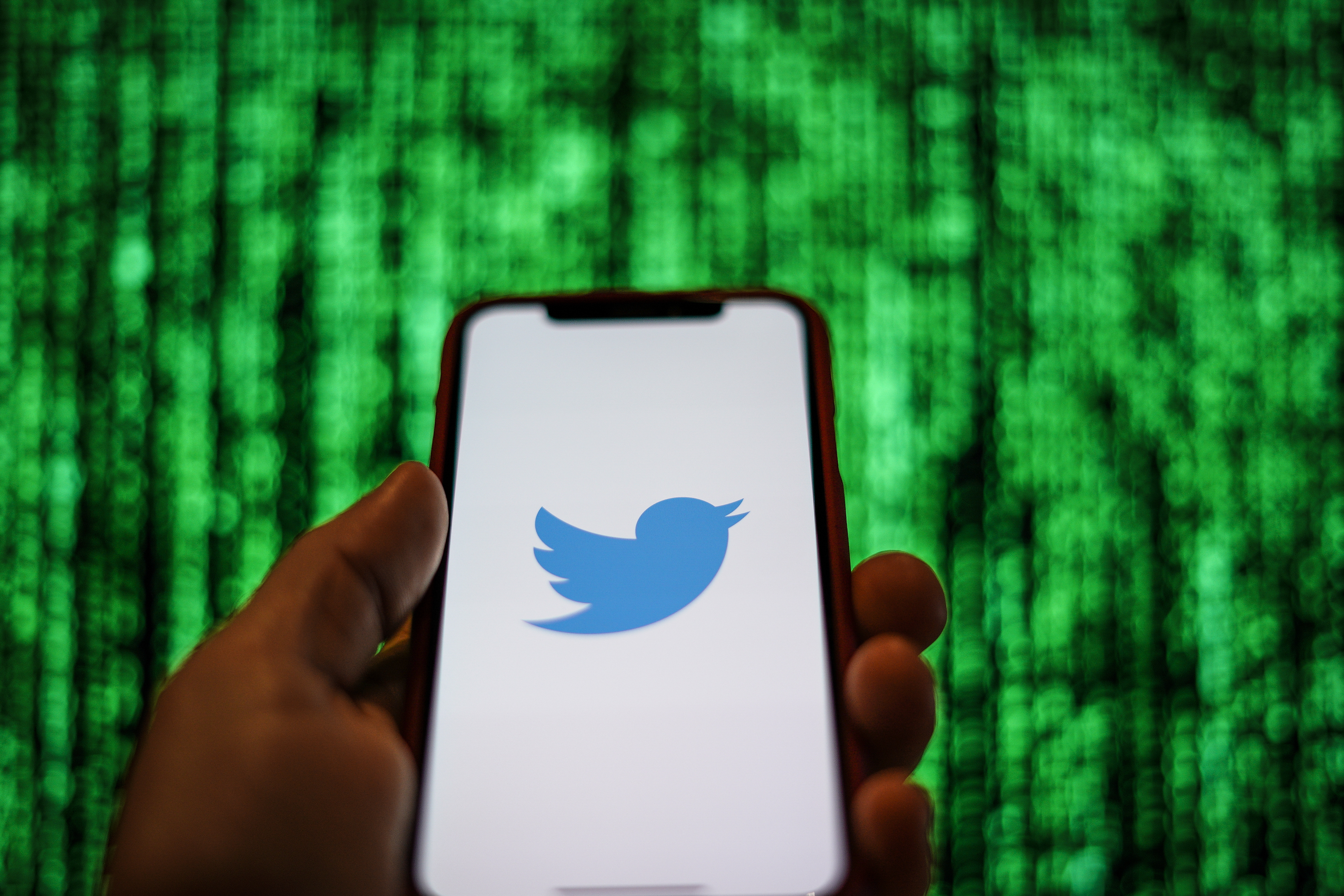 The Twitter logo is seen displayed on a mobile device in front of a screen with data in this photo illustration in Warsaw, Poland on March 19, 2019. (Photo by Jaap Arriens/NurPhoto via Getty Images)