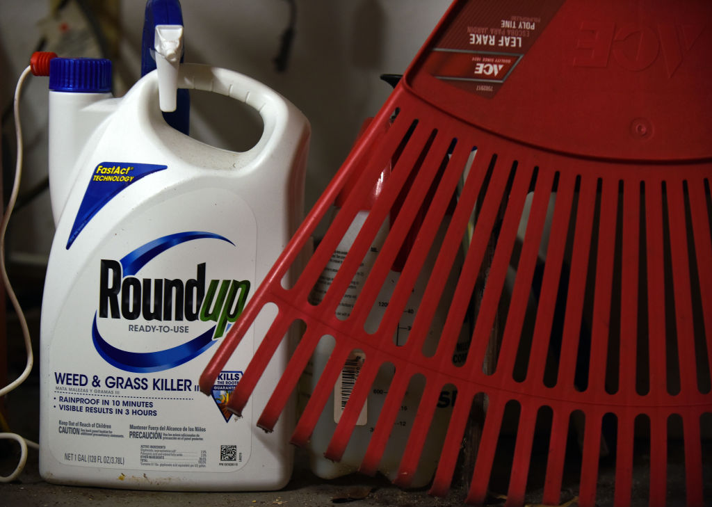 Roundup weedkiller with rake