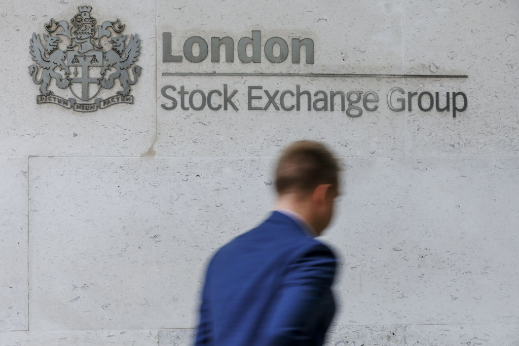Man walks by London Stock Exchange Group logo