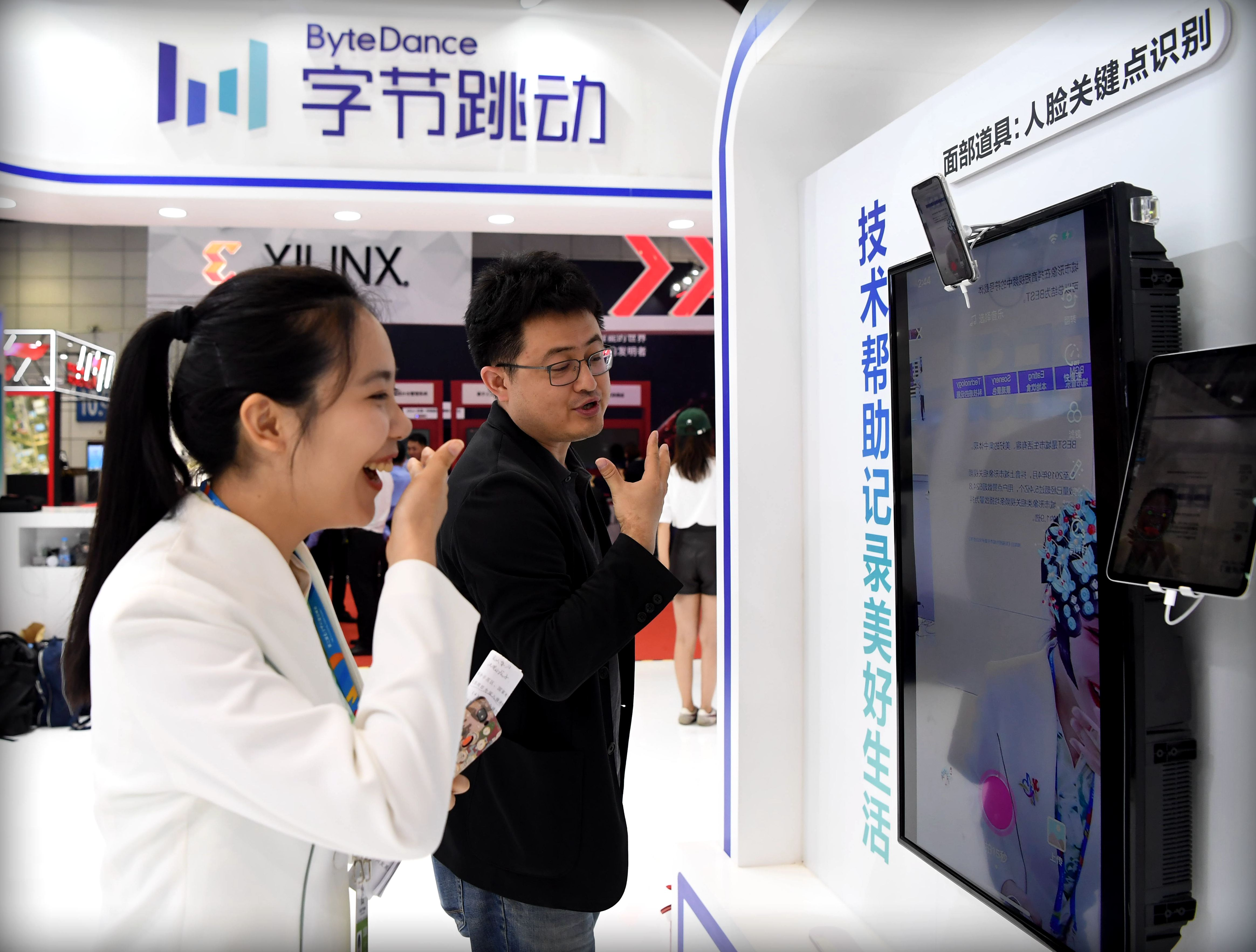 People visit a ByteDance stand
