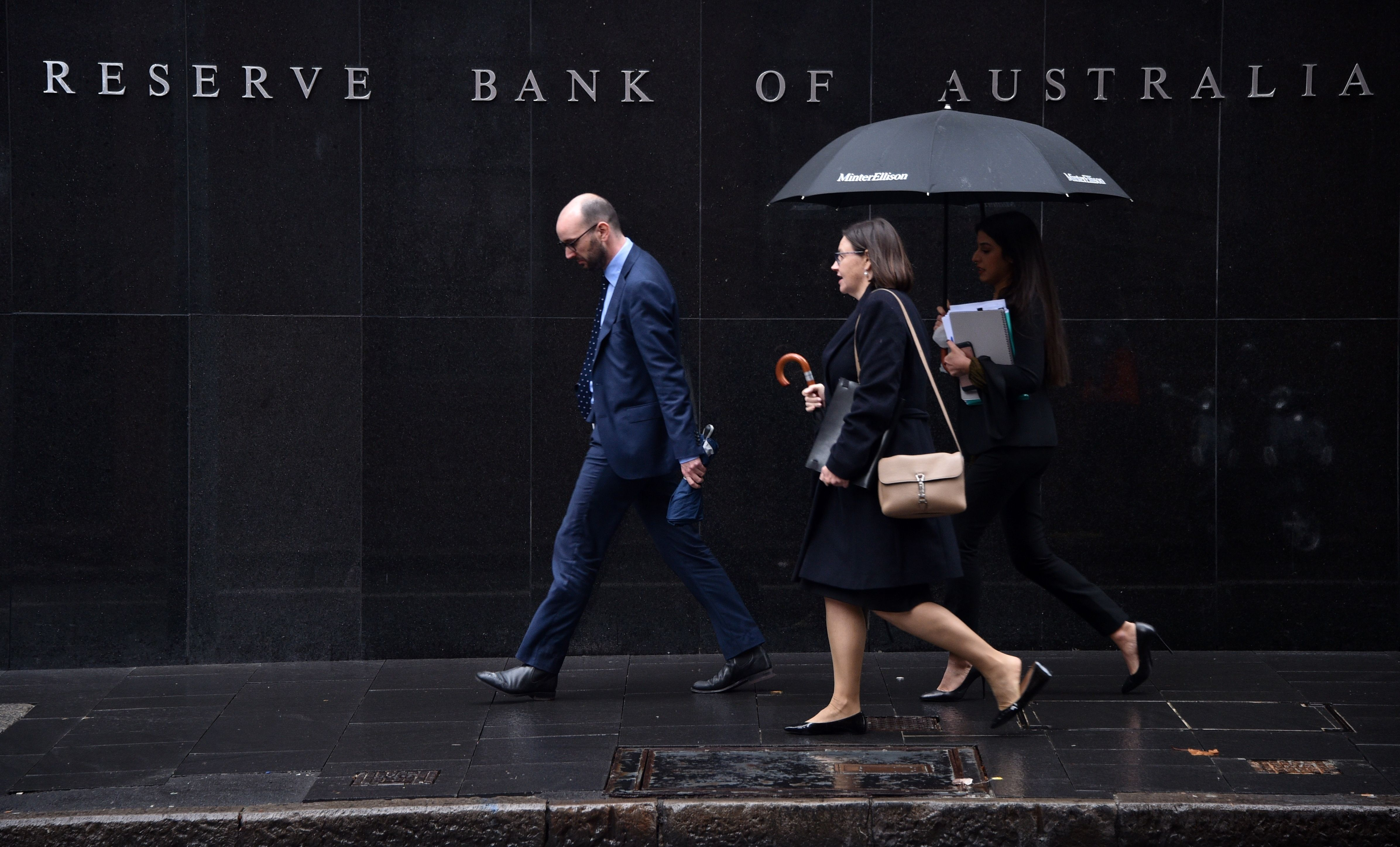 Pedestrians walks past the Reserve Bank of Australia in Sydney on June 4, 2019. - The Reserve Bank cut interest rates by 25 basis points to a historic low of 1.25 percent, as the pace of growth slowed to levels not seen since the global financial crisis. (Photo by PETER PARKS / AFP)        (Photo credit should read PETER PARKS/AFP/Getty Images)