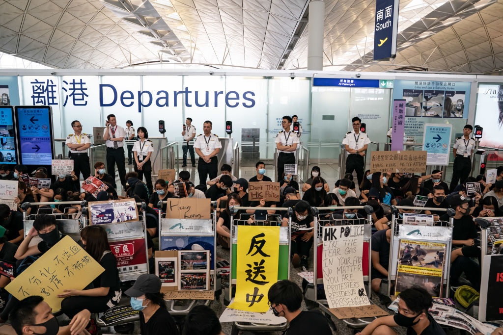Protesters occupy the departure hall of the Hong Kong International Airport during a demonstration on August 13, 2019. Hong Kong has once again made airports the scene of political protests.