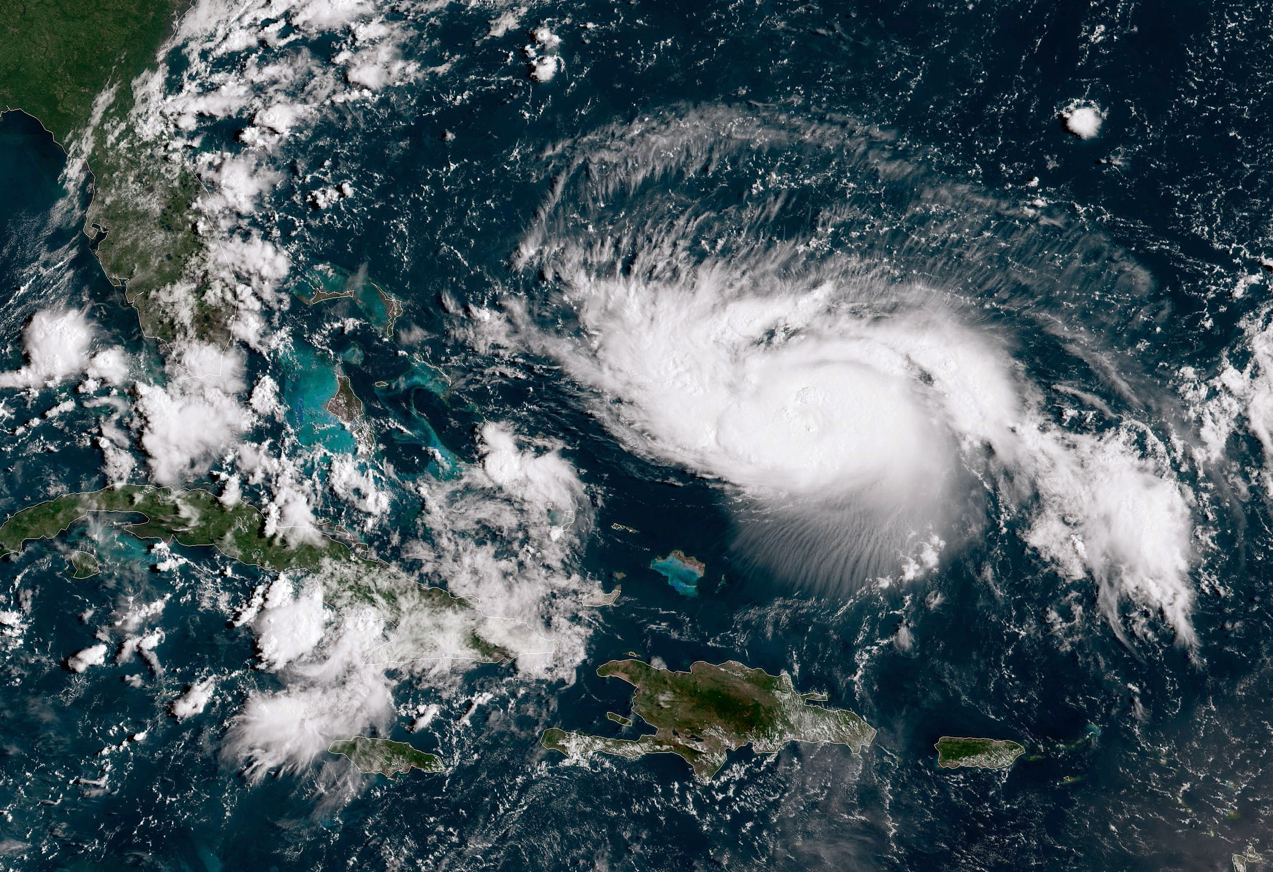 In this NOAA GOES-East satellite image, Hurricane Dorian, now a Cat. 2 storm with maximum sustained winds of 110 mph, gains strength as it tracks towards the Florida coast taken at 13:40Z August 30, 2019 in the Atlantic Ocean.