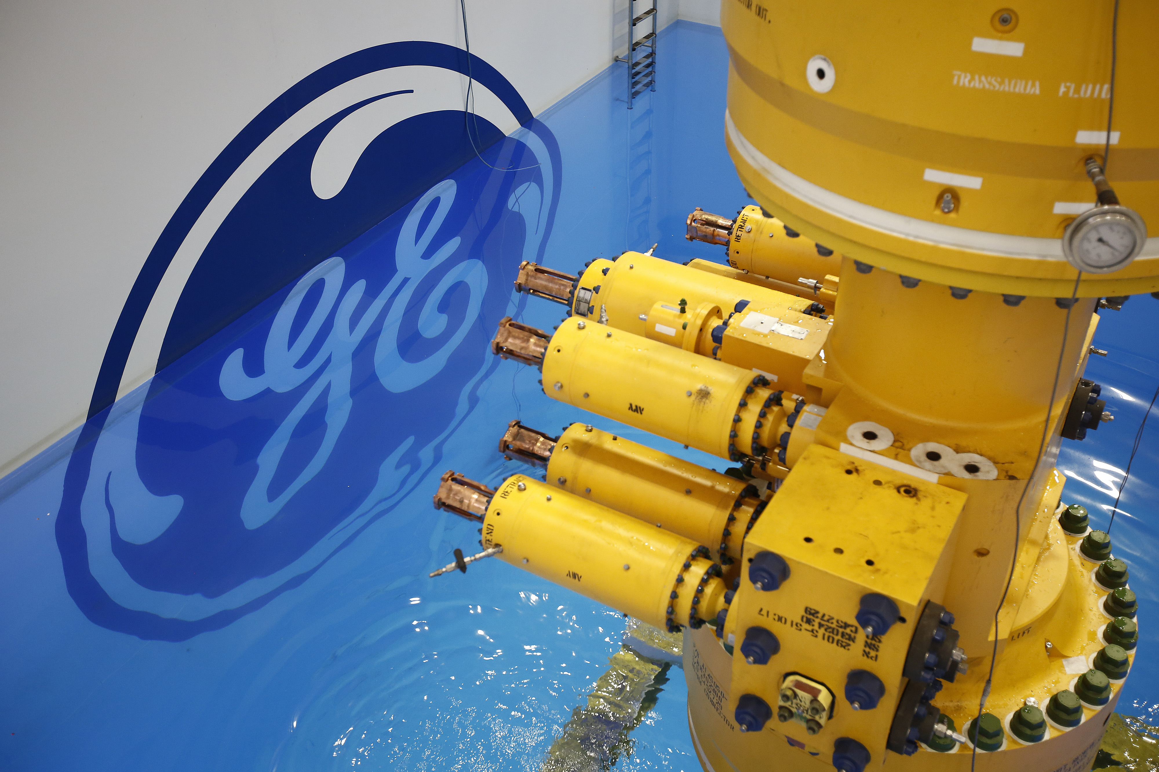 FILE PHOTO: A subsea oil and gas tree is lowered into a testing pool at the General Electric Co. (GE) manufacturing plant in Montrose, U.K. Photographer: Simon Dawson/Bloomberg via Getty Images