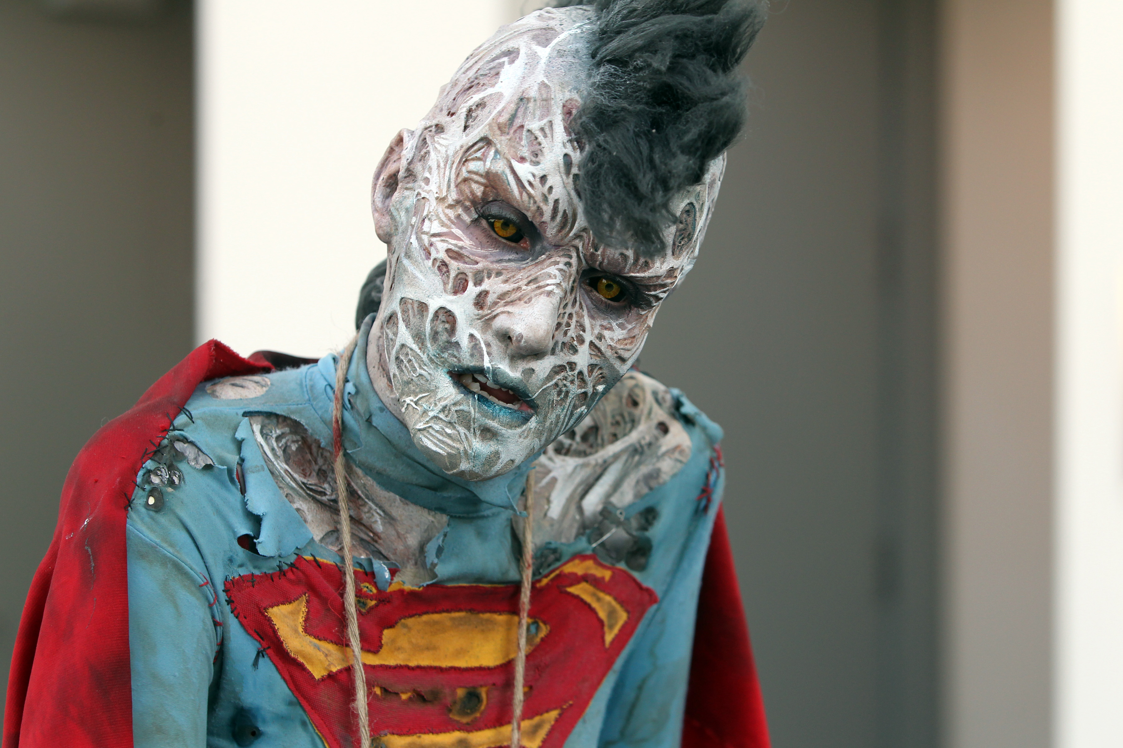 A woman made up by Cinema Makeup School plays a female Bizarro from the comic strip of the same name during Comic-Con International 2016 in San Diego, California, July 23, 2016.