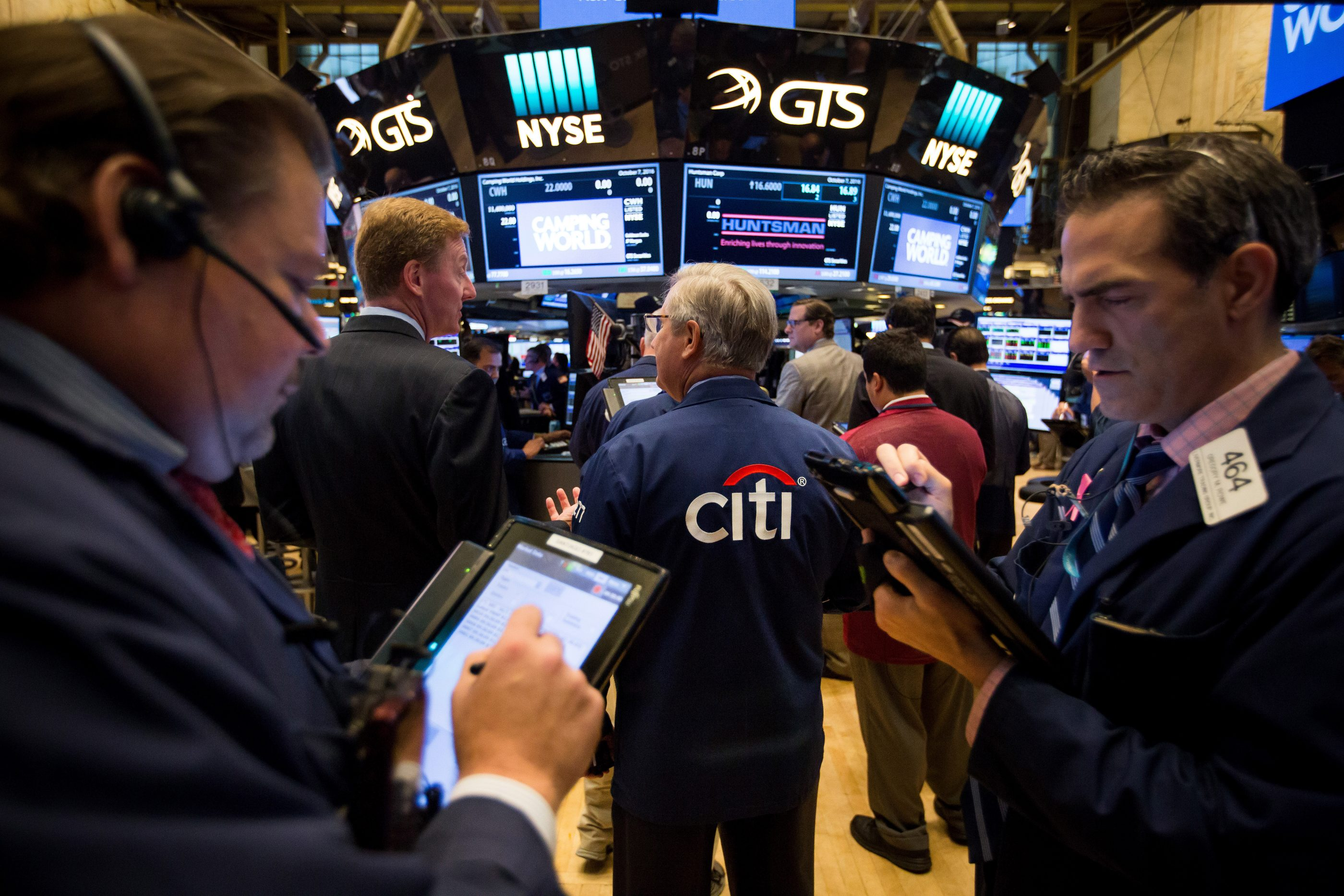 A trader wears a Citigroup jacket while working on the floor of the New York Stock Exchange.
