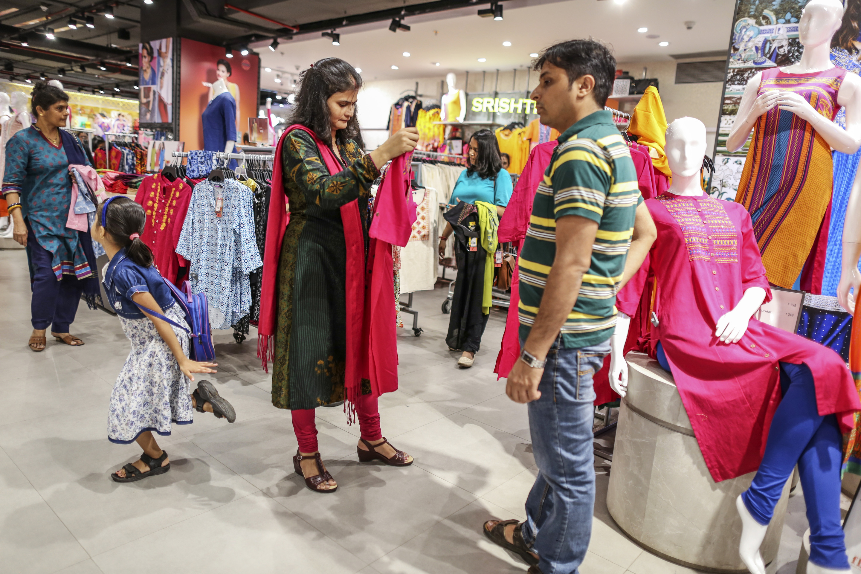 Customers shop at a Big Bazaar hypermarket, part of Future Retail Ltd., Mumbai, India. Amazon is close to securing as much as a 10% stake in India's second-largest retail company.