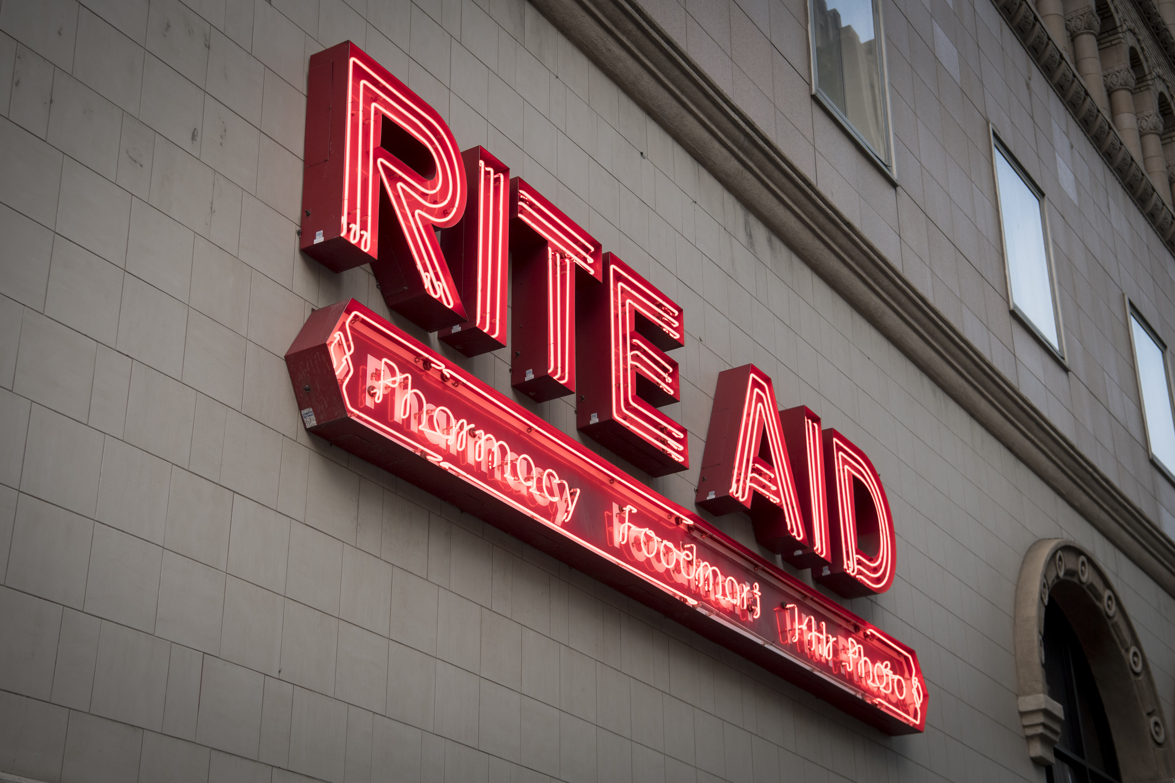 A red neon sign for the drug store Rite Aid