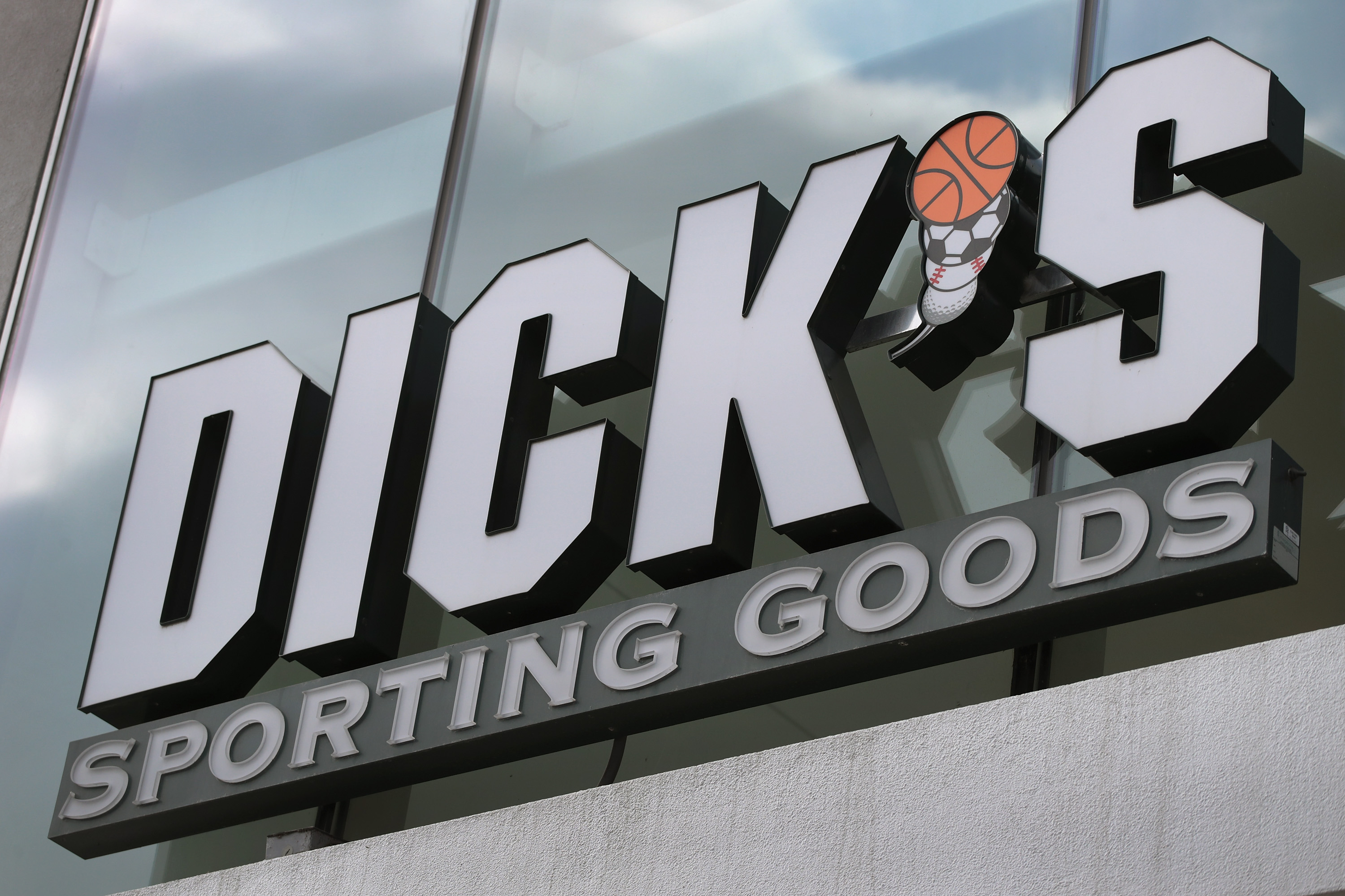 A sign hangs outside of a Dick's Sporting Goods store on February 28, 2018 in Chicago, Illinois.