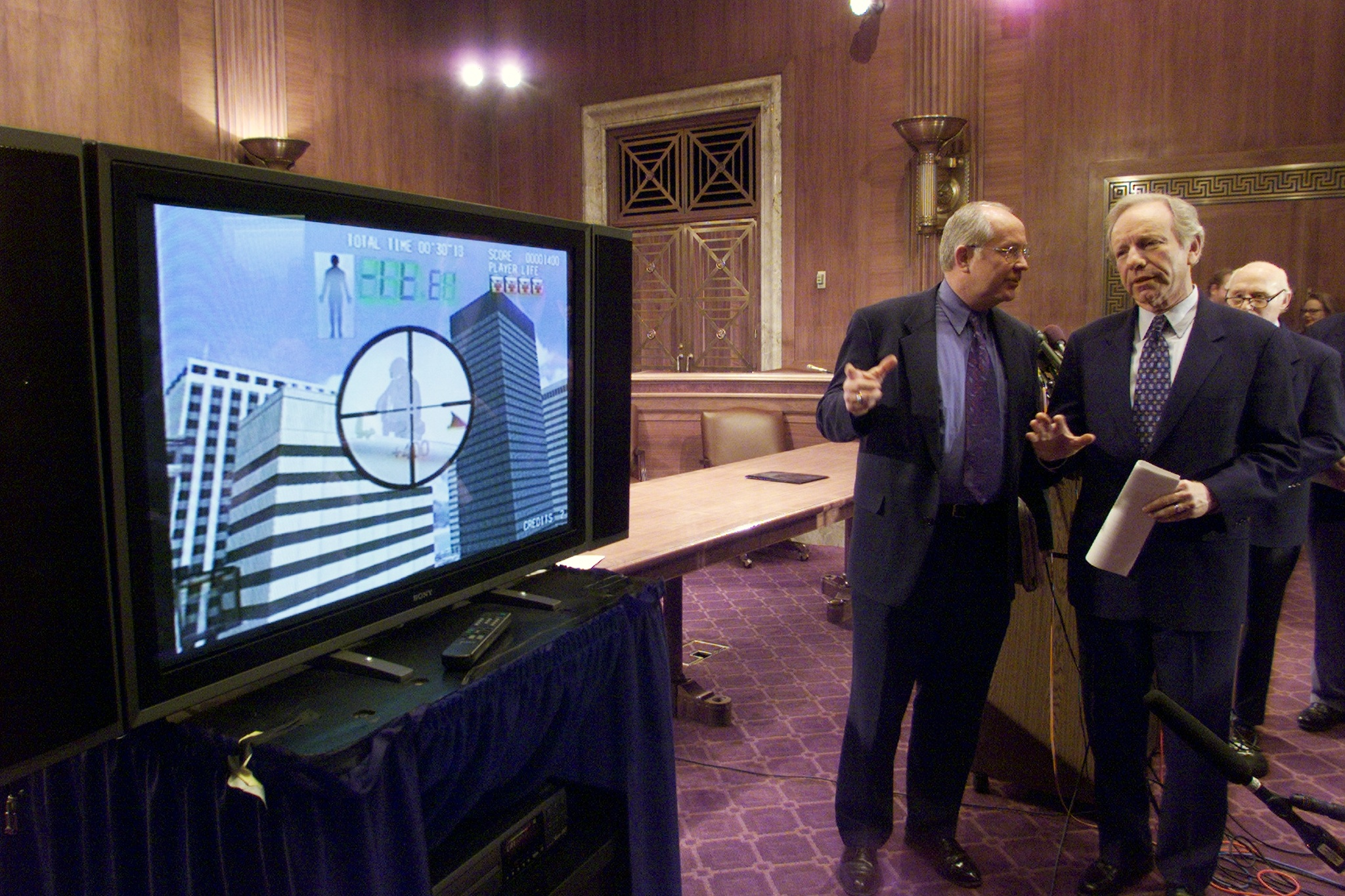 Sen. Joseph Lieberman (D-Conn.) watches videos with David Wa
