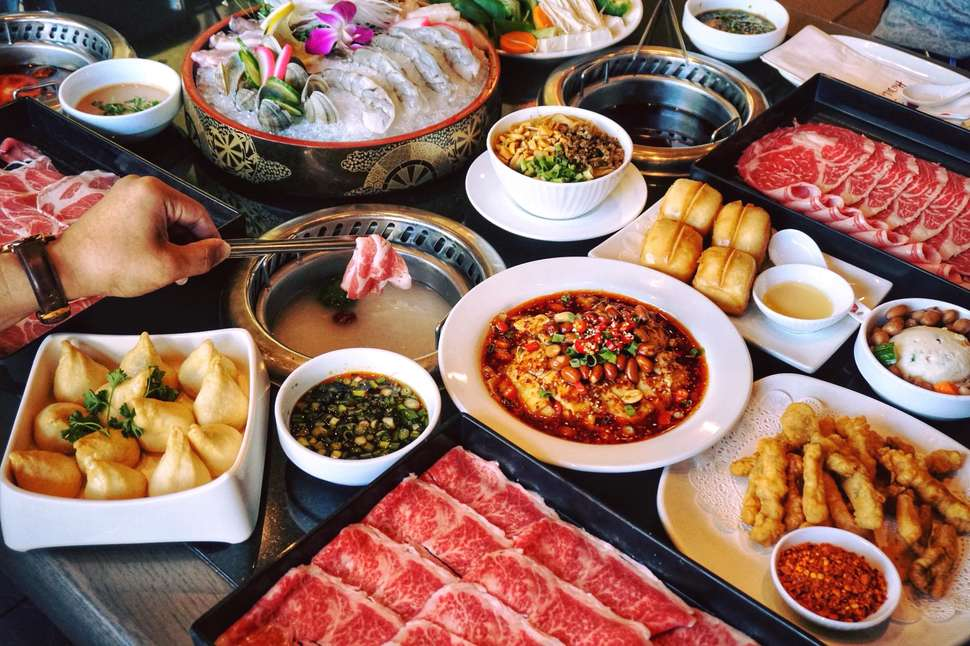 The spread at Hai Di Lao,  chain of hot pot restaurants founded in Jianyang, Chengdu, Sichuan Province, China, in 1994.