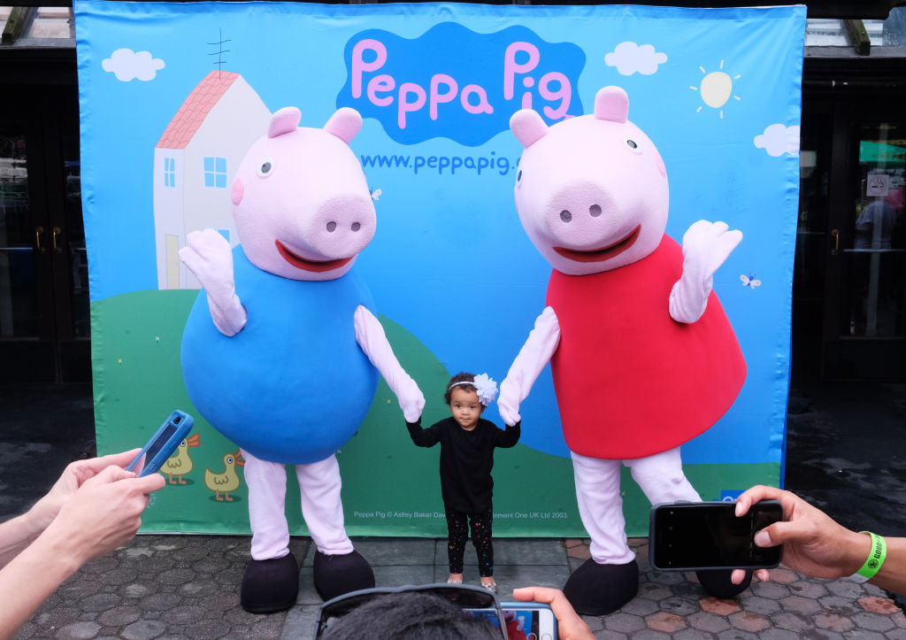 Children pose with Peppa Pig at a benefit in New York City in 2018. Hasbro has agreed to buy the studio that owns the rights to Peppa Pig for $4 billion