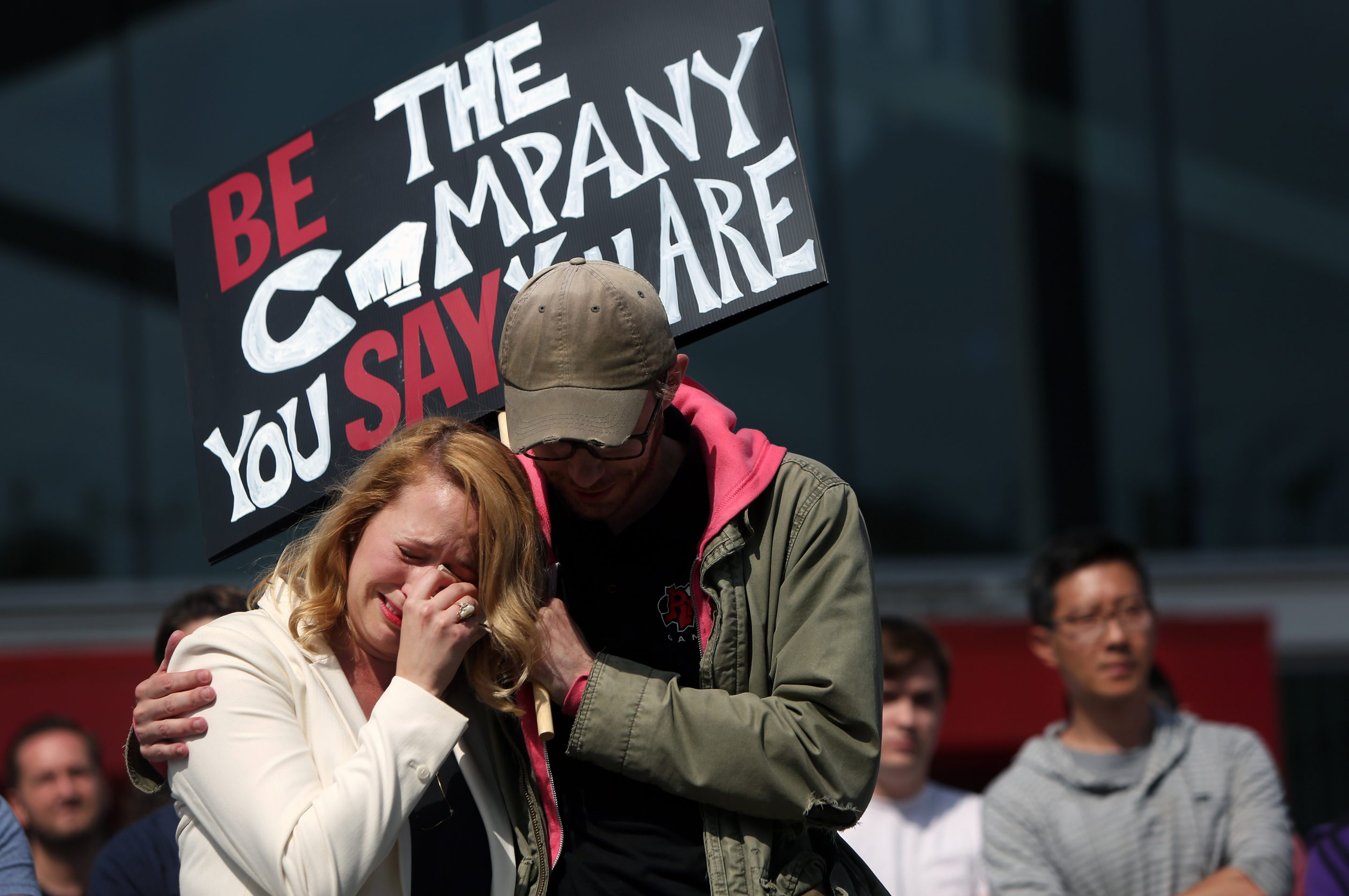 LOS ANGELES, CA - MAY 06: Chanel Dawnée, left, embraces Andy Dohr, right, after he spoke during a staged walk out at Riot Games to protest the company's move to force arbitration on sexual harassment lawsuits on May 6, 2019, in Los Angeles, California. Dawnée is one of the plaintiffs in a suit against Riot Games. (Photo By Dania Maxwell/Los Angeles Times via Getty Images)