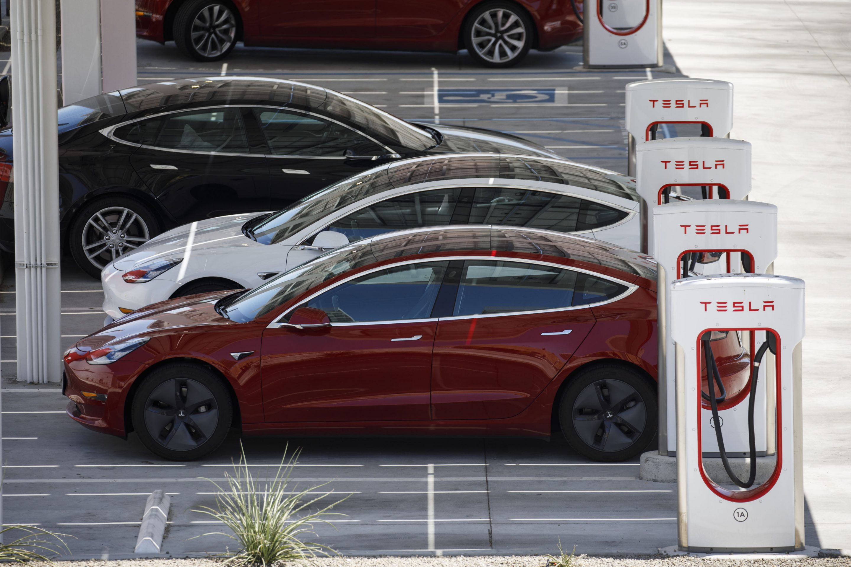 Tesla Inc. Model 3 electric vehicles charge at the Tesla Supercharger station in Kettleman City, California, U.S., on Wednesday, July 31, 2019.