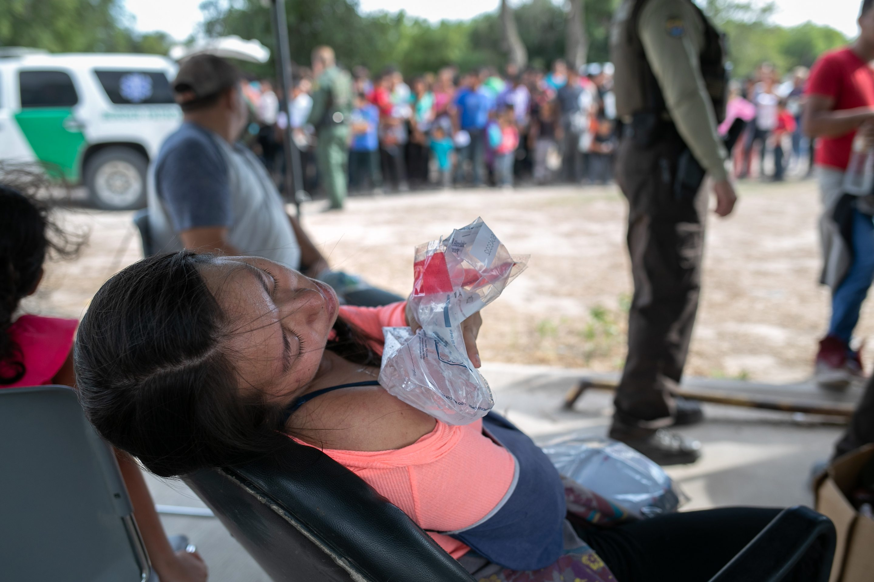 An immigrant from Guatemala ices her shoulder after she was taken into custody by U.S. border agents on July 02, 2019 in Los Ebanos, Texas.