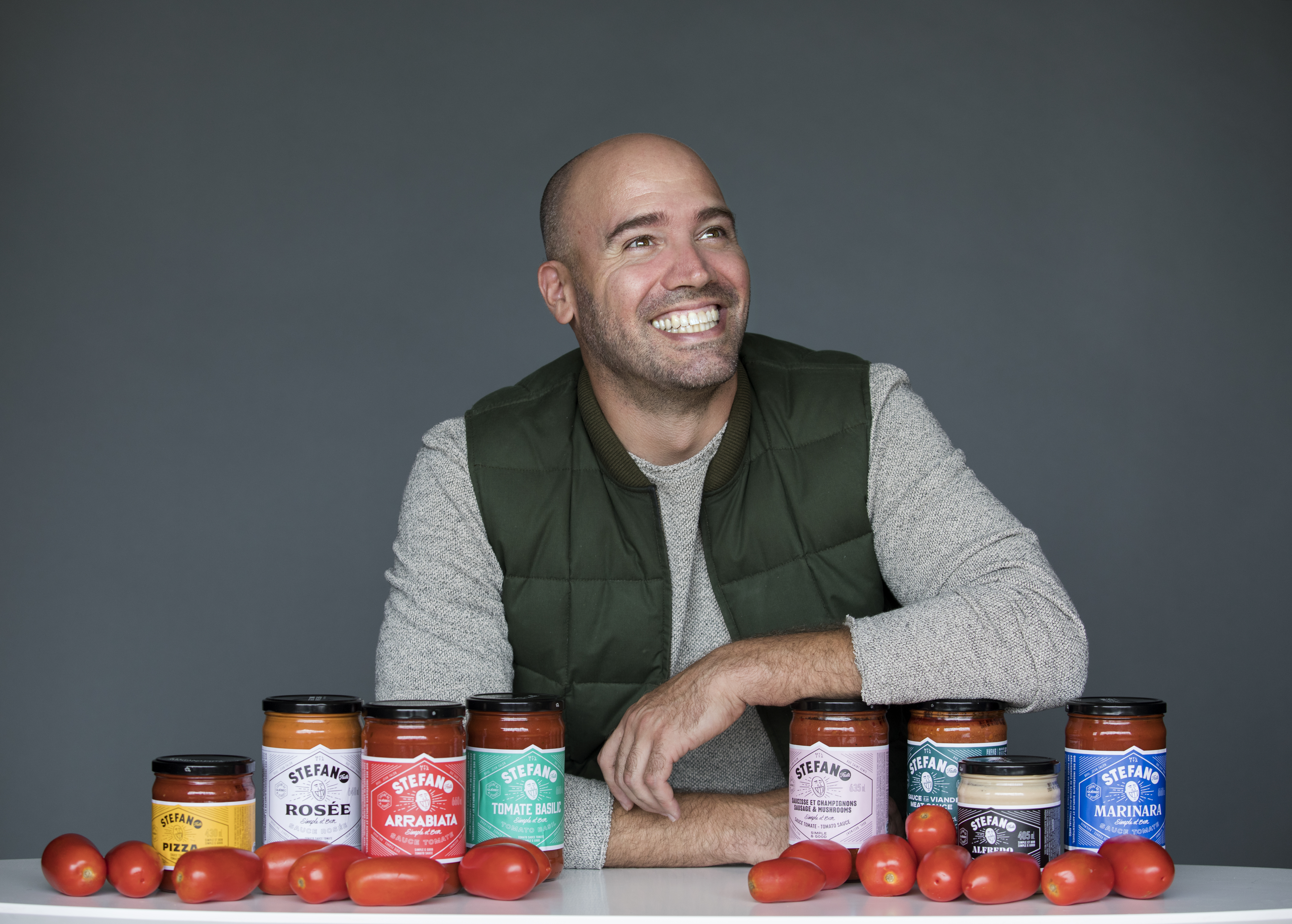 Stefano Faita poses with eight out of ten of Stefano Sauce options.