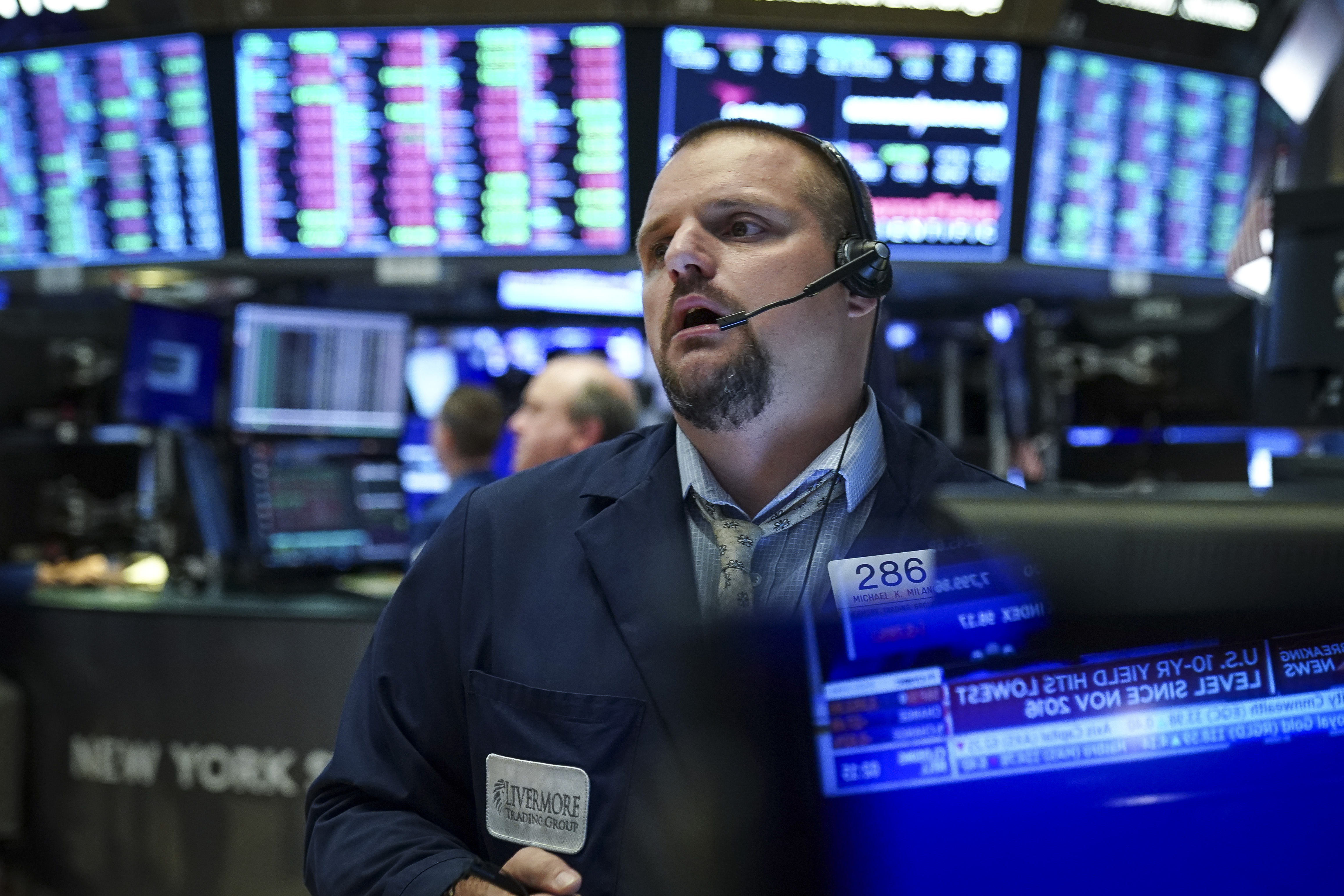 NEW YORK, NY - AUGUST 1: Traders and financial professionals work ahead of the closing bell on the floor of the New York Stock Exchange (NYSE) on August 1, 2019 in New York City. Following large gains earlier in the day, U.S. markets dropped sharply after an afternoon tweet by U.S. President Donald Trump announcing his plans to impose a 10 percent tariff on an additional $300 billion worth of Chinese imports. His announcement said the new tariffs will take effect on September 1. (Photo by Drew Angerer/Getty Images)