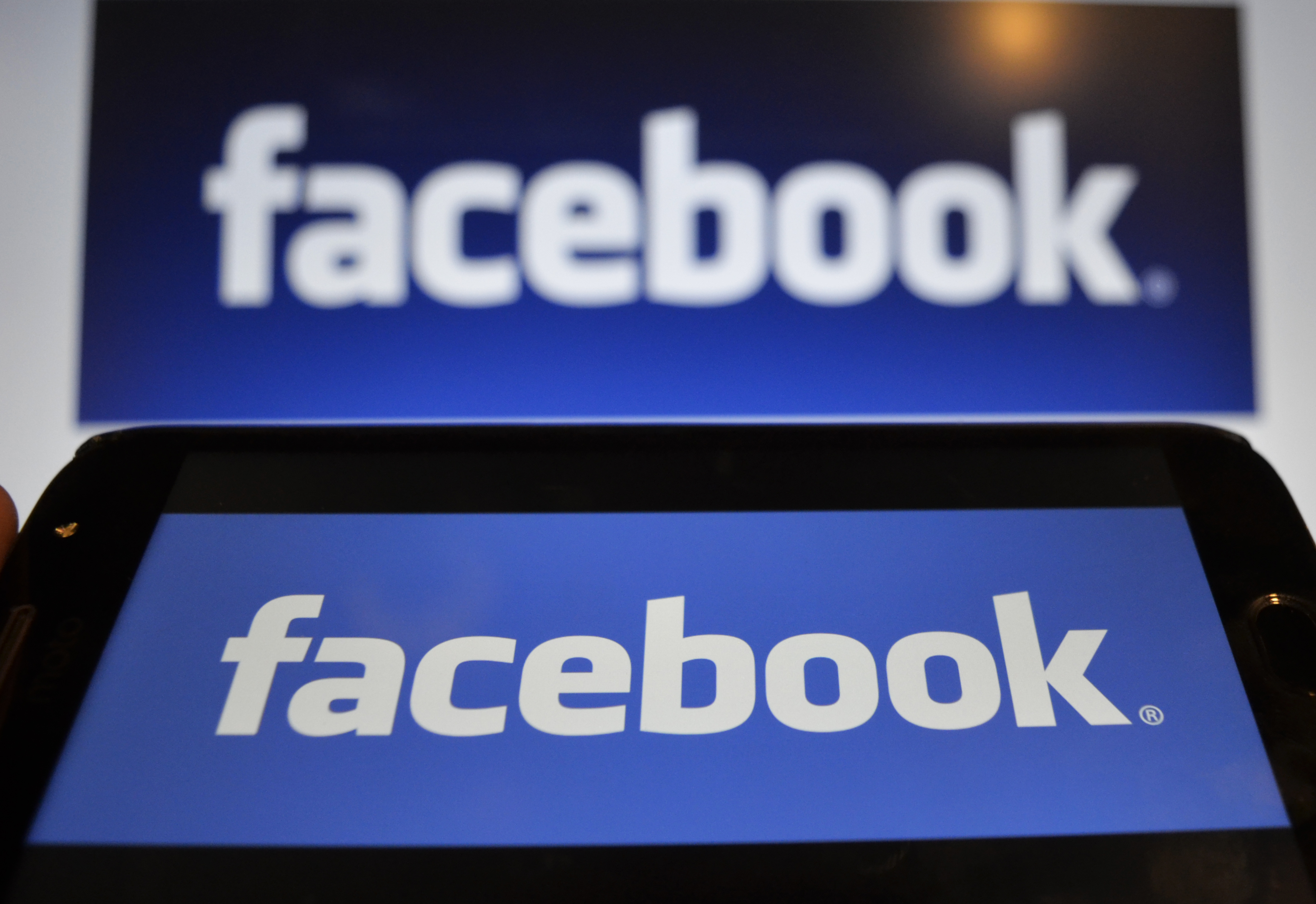In this photo illustration a Facebook logo can be seen on a mobile screen as well as on a laptop screen, Kolkata, India, 16 August, 2019.Facebook users sues the world's largest social media network over a 2018 data breach which failed to warn data risks tied to its single sign-on tools even though it protected its employees according to an Indian media report.