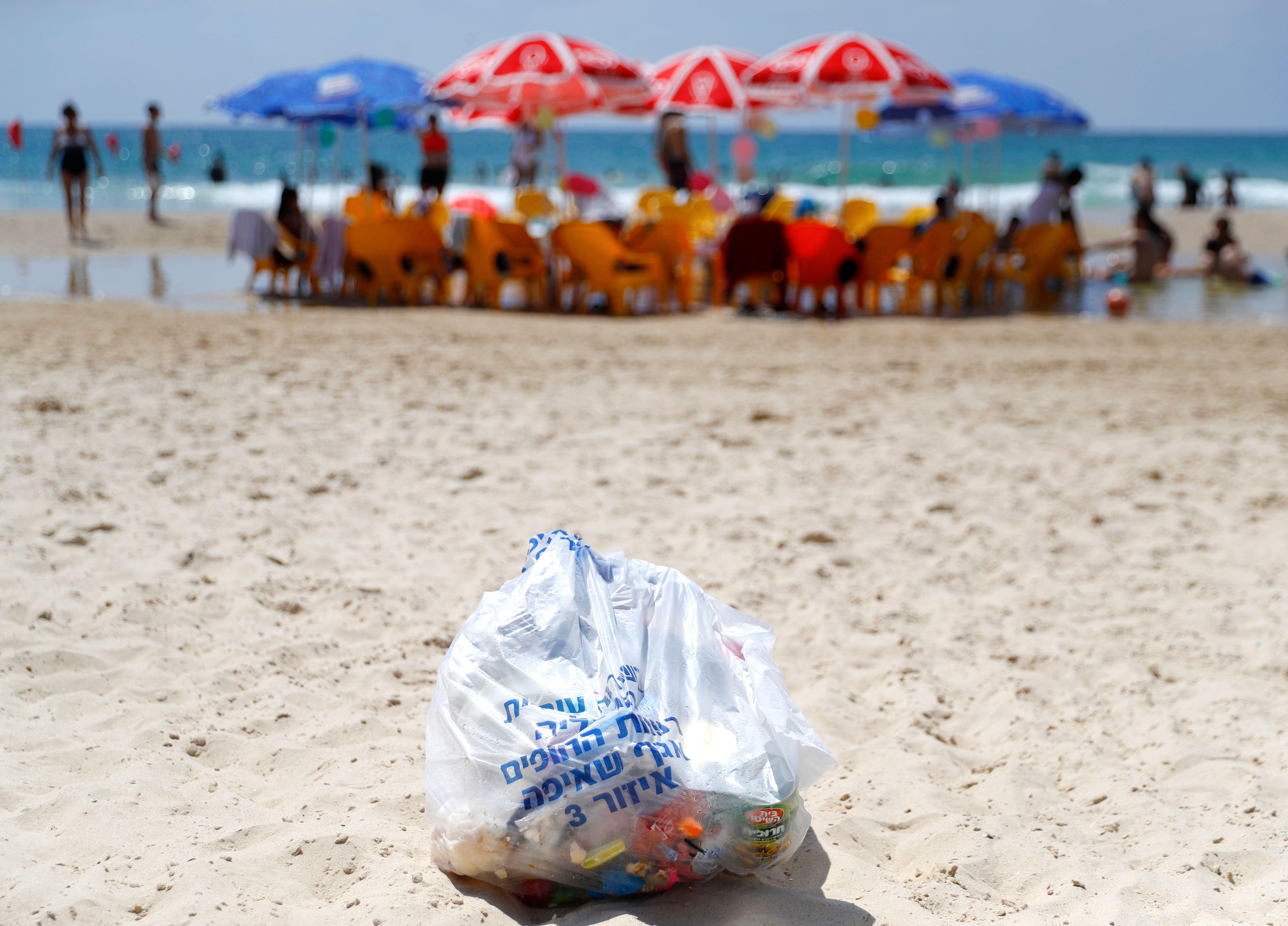 Plastic trash bag on beach