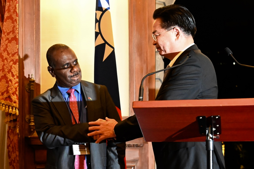 Taiwan's Foreign Minister Joseph Wu (R) shakes hands with Solomon Islands' Foreign Minister Jeremiah Manele (L) during a press conference at the Taipei Guest House in Taipei on September 9, 2019. - Taiwan's president on September 9 urged the Solomon Islands not to switch diplomatic allegiance to China, as the Pacific nation deliberates whether to recognise the far more economically powerful Beijing instead. (Photo by Sam YEH / AFP) (Photo credit should read SAM YEH/AFP/Getty Images)