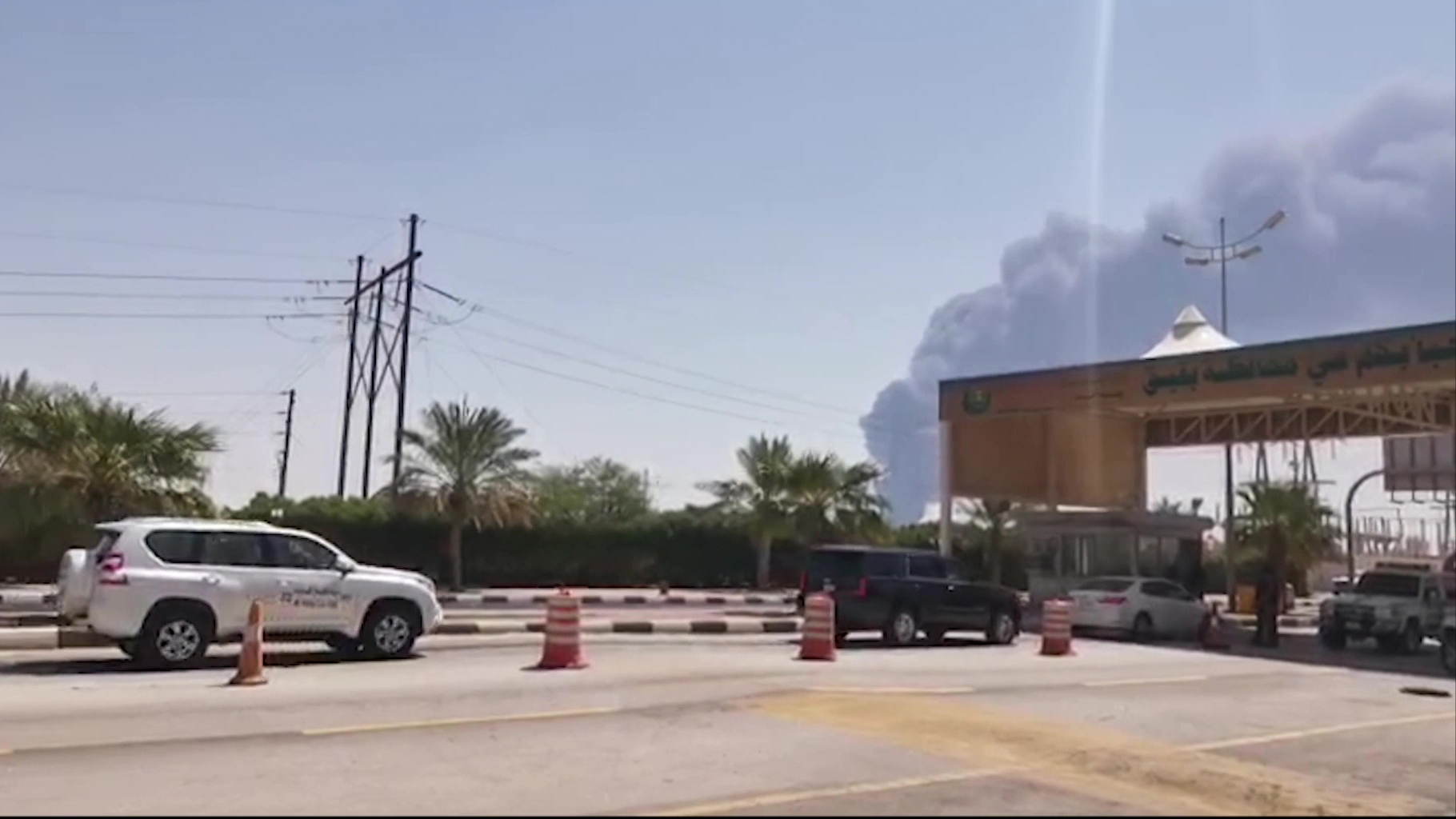 This AFPTV screen grab from a video made on September 14, 2019, shows smoke billowing from an Aramco oil facility in Abqaiq about 60km (37 miles) southwest of Dhahran in Saudi Arabia's eastern province.