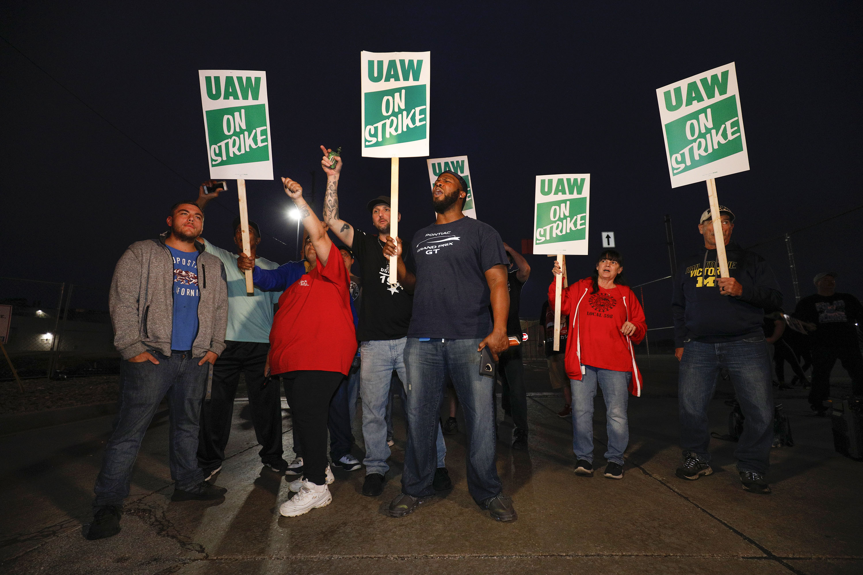 FLINT, MI - SEPTEMBER 16: United Auto Workers (UAW) members walk the picket line at the General Motors Flint Assembly Plant after the UAW declared a national strike against GM at midnight on September 16, 2019 in Flint, Michigan. It is the first national strike the UAW has declared since 1982.