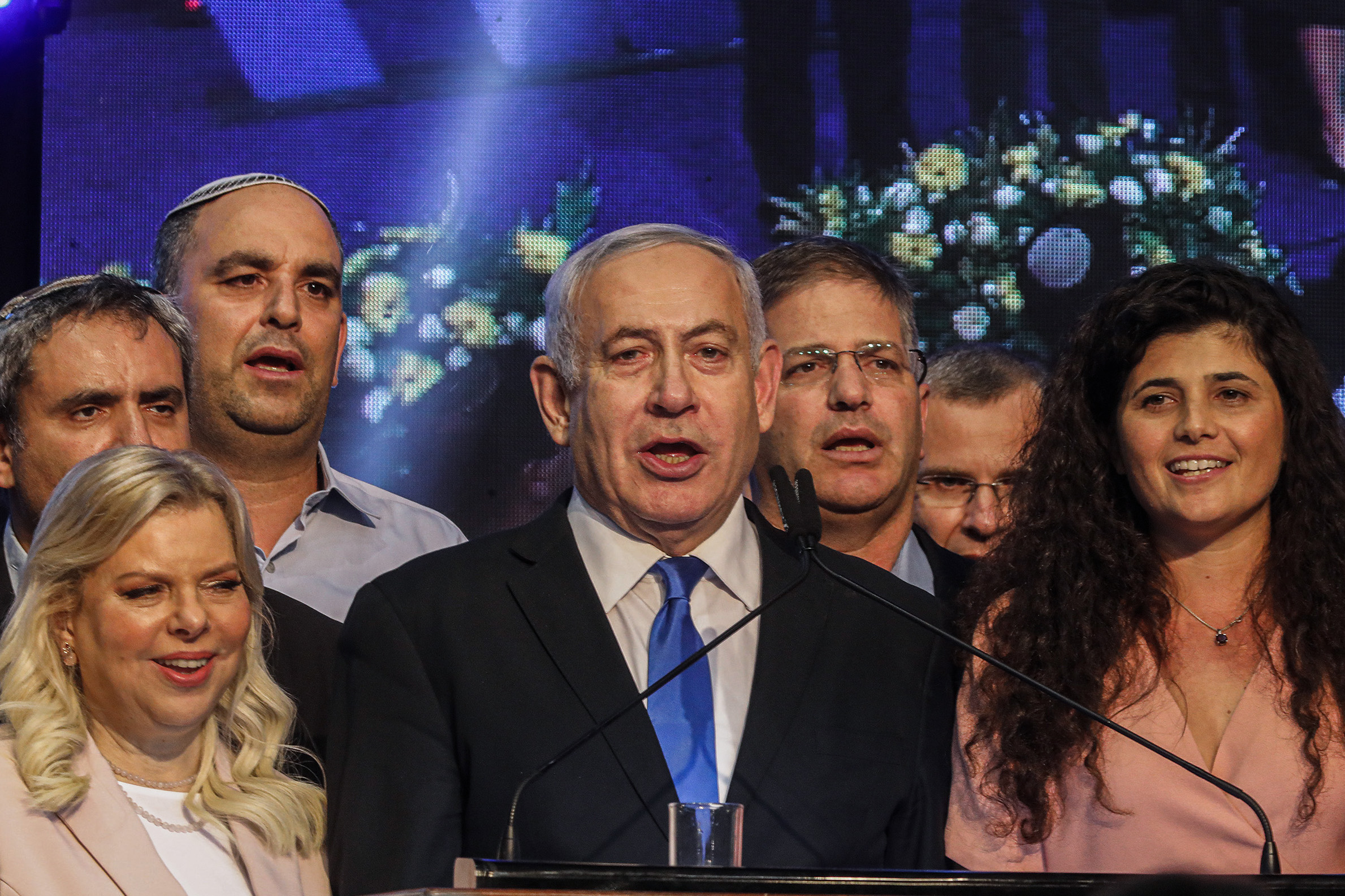 18 September 2019, Israel, Tel Aviv: Israeli Prime Minister Benjamin Netanyahu stands next to his wife Sara (L) as he delivers a speech to supporters of his Likud party after polls closed in the Israeli parliamentary elections. Photo: Ilia Yefimovich/dpa (Photo by Ilia Yefimovich/picture alliance via Getty Images)