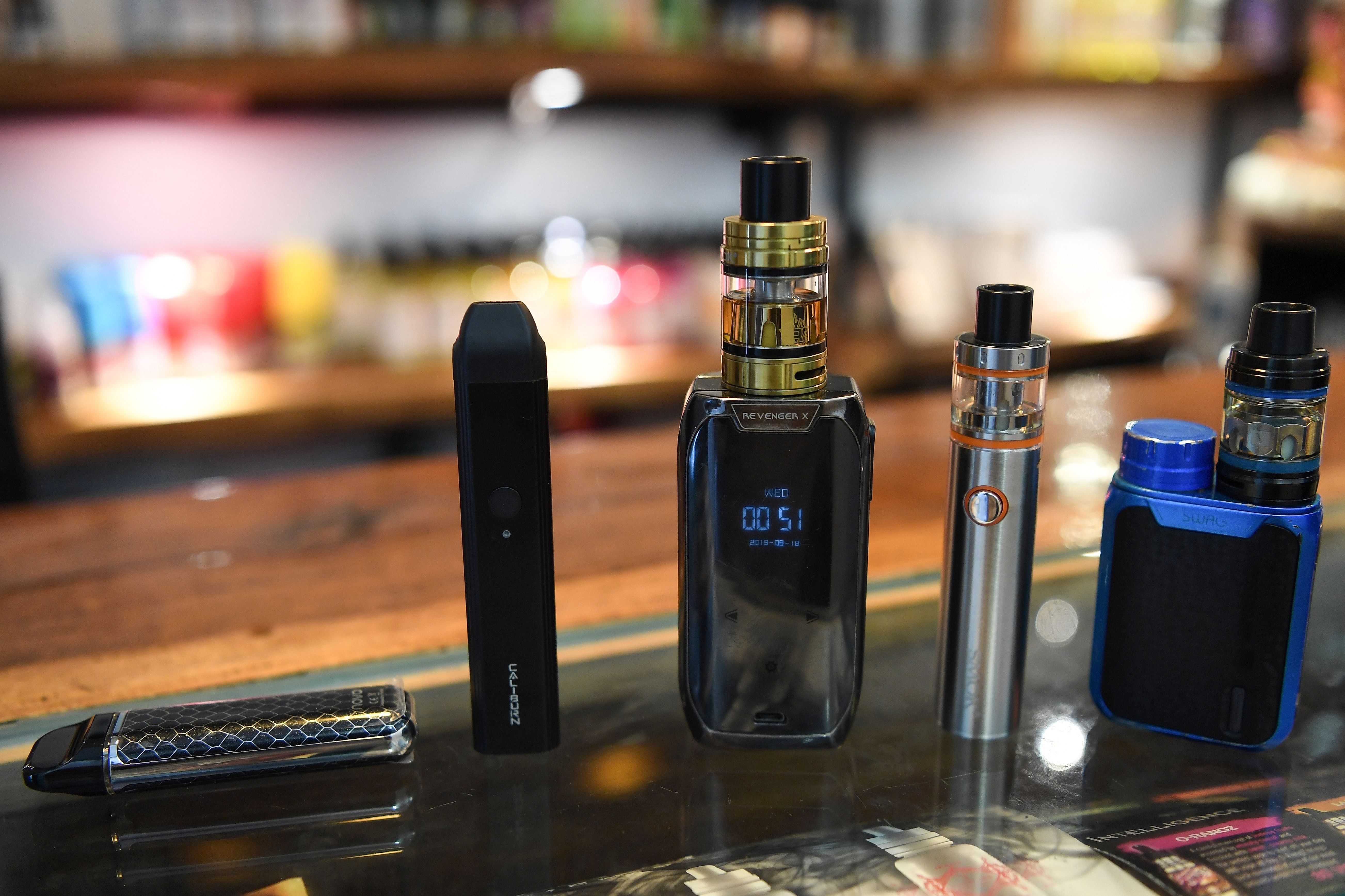 Electronic cigarette devices are pictured on display at a vaping shop in New Delhi on September 18, 2019. - India banned on September 18 the sale of electronic cigarettes, as a backlash gathers pace worldwide due to health concerns about a product promoted as less harmful than smoking tobacco. (Photo by Prakash SINGH / AFP) (Photo credit should read PRAKASH SINGH/AFP/Getty Images)